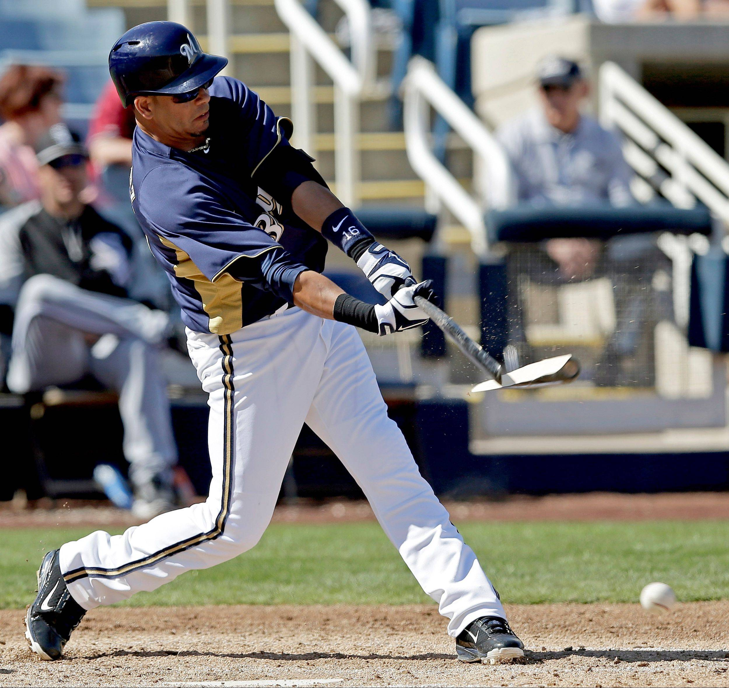 Milwaukee Brewers third baseman and former Cub Aramis Ramirez breaks his bat in an exhibition game last Thursday. Ramirez sprained his left knee Saturday when sliding into second, and the Brewers must be relieved the injury wasn't worse.