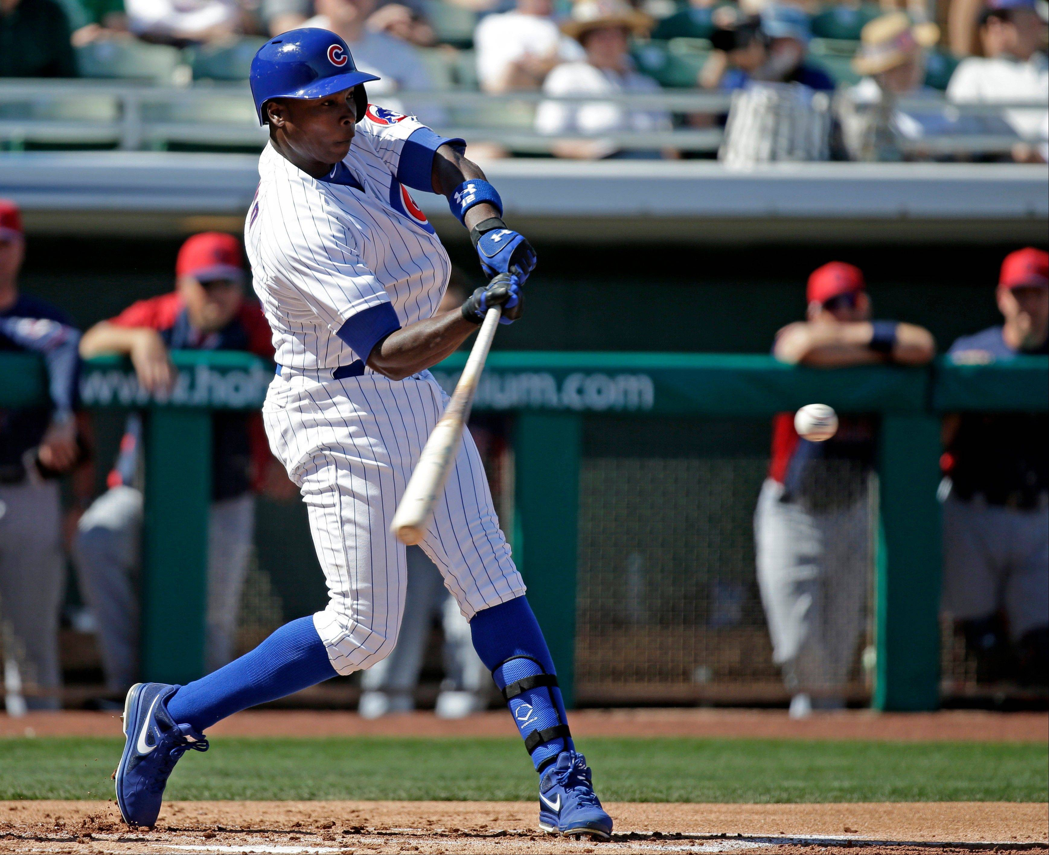 Chicago Cubs' Alfonso Soriano hits a home run during the second inning of an exhibition spring training baseball game against the Cleveland Indians Monday, March 4, 2013, in Mesa, Ariz.