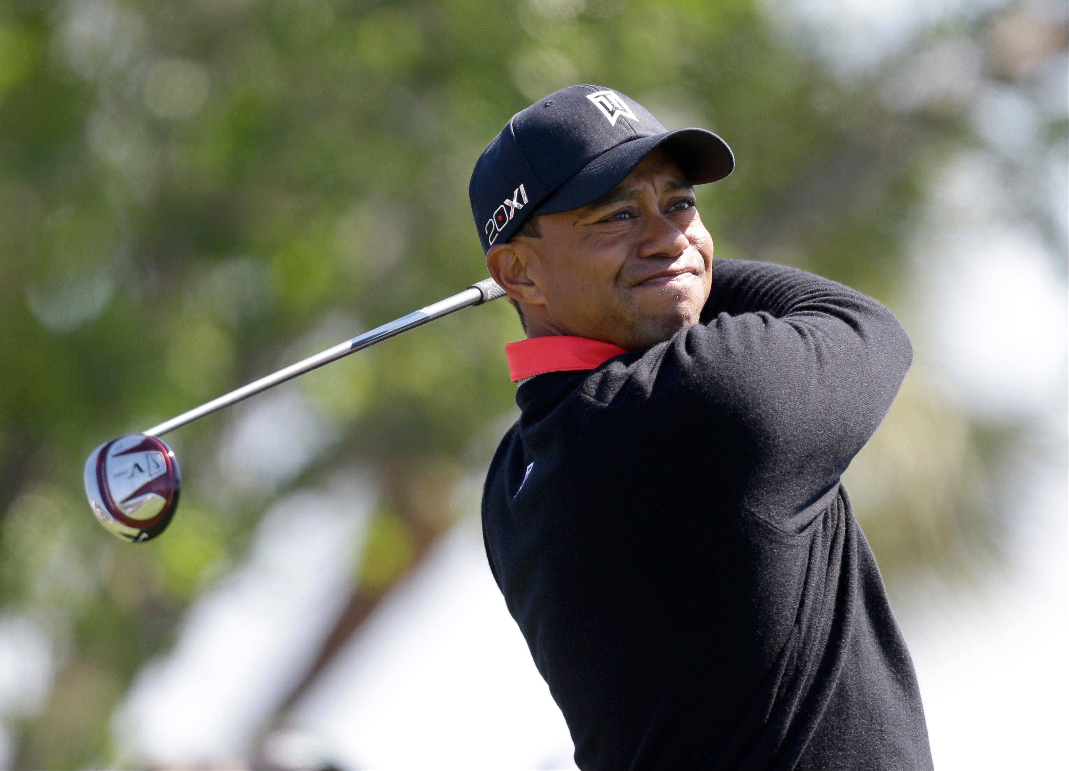 Tiger Woods tees off on the fourth tee during the final round of the Honda Classic golf tournament on Sunday, March 3, 2013, in Palm Beach Gardens, Fla. Retired golfer Jack Nicklaus says he thinks Woods can break his record, but he better get to it.
