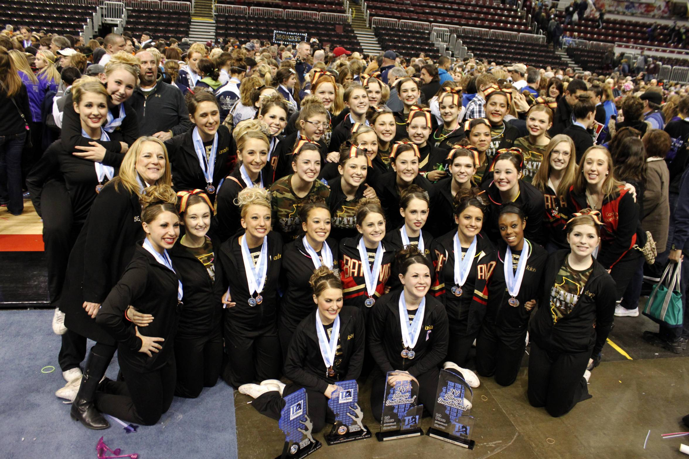 Batavia High School JV and Varsity Dance Team proudly display the four trophies they won at State in Peoria on March 3, 2013.
