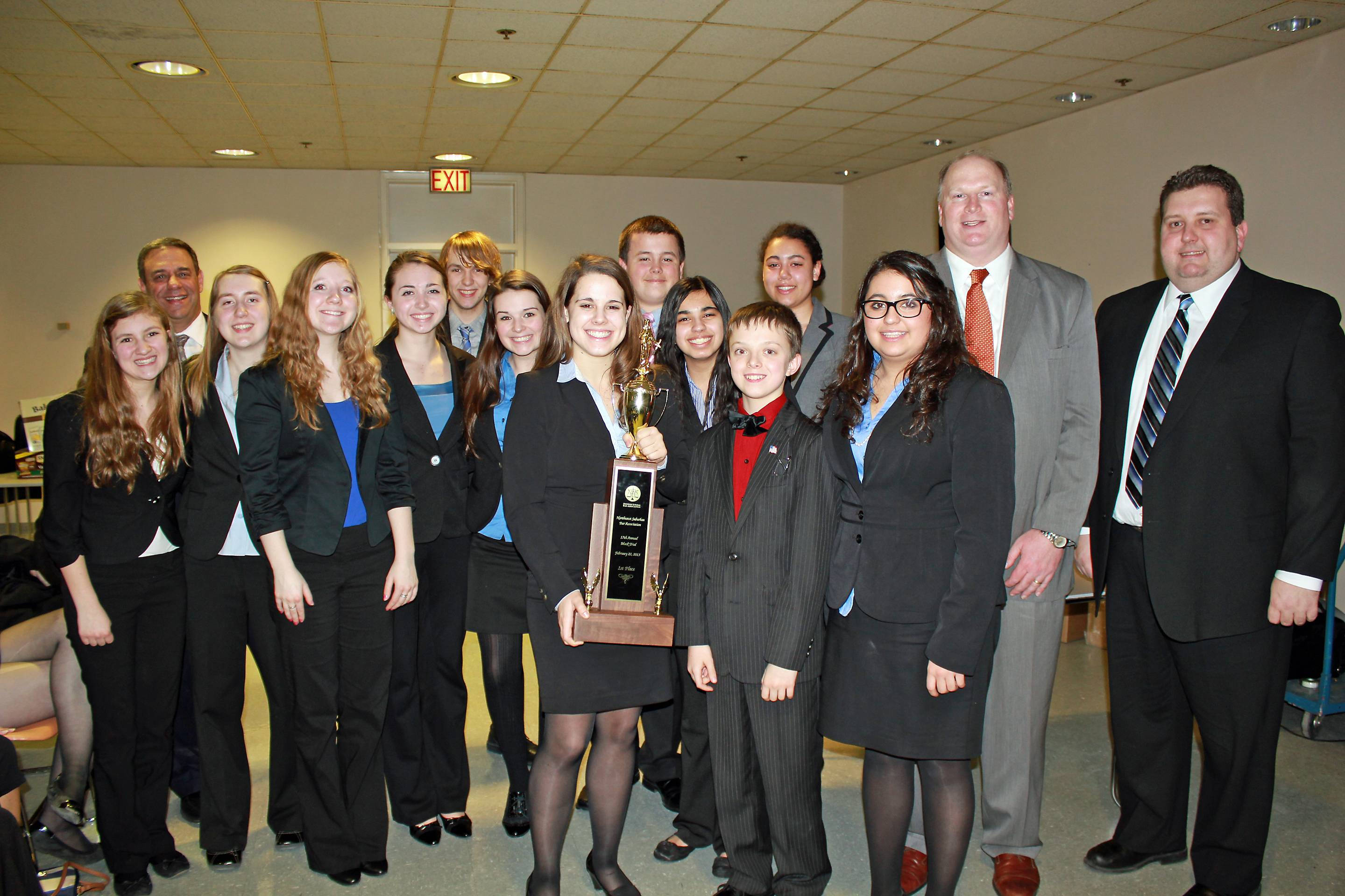 Members of the St. Charles North High School Mock Trial team receive the first-place trophy after winning the Northwest Suburban Bar Association's 17th annual Mock Trial Invitational on Feb. 21. Also pictured are Neil H. Good, president of the NWSBA (far left, in the back) and Richard Karwaczka (far right) and Jay Andrew, co-chairs of the Mock Trial event.