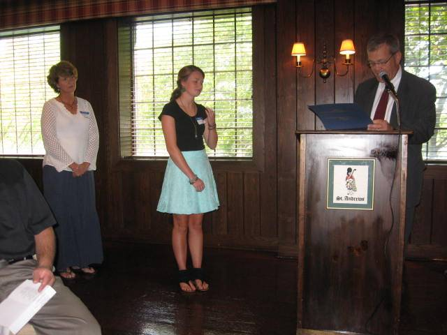 2012 Scholarship recipient Blythe Todd receives her award certificate from Lions Club President Fred Bucholz as her mother looks on.