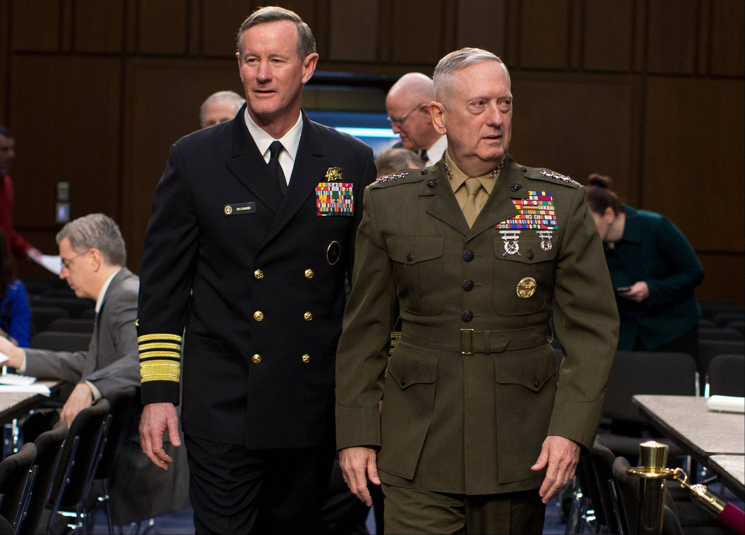 Marine Gen. James Mattis, commander, U.S. Central Command, right, followed by Navy Adm. William McRaven, commander, U.S. Special Operations Command, arrive on Capitol Hill Tuesday to testifie before a Senate committee.