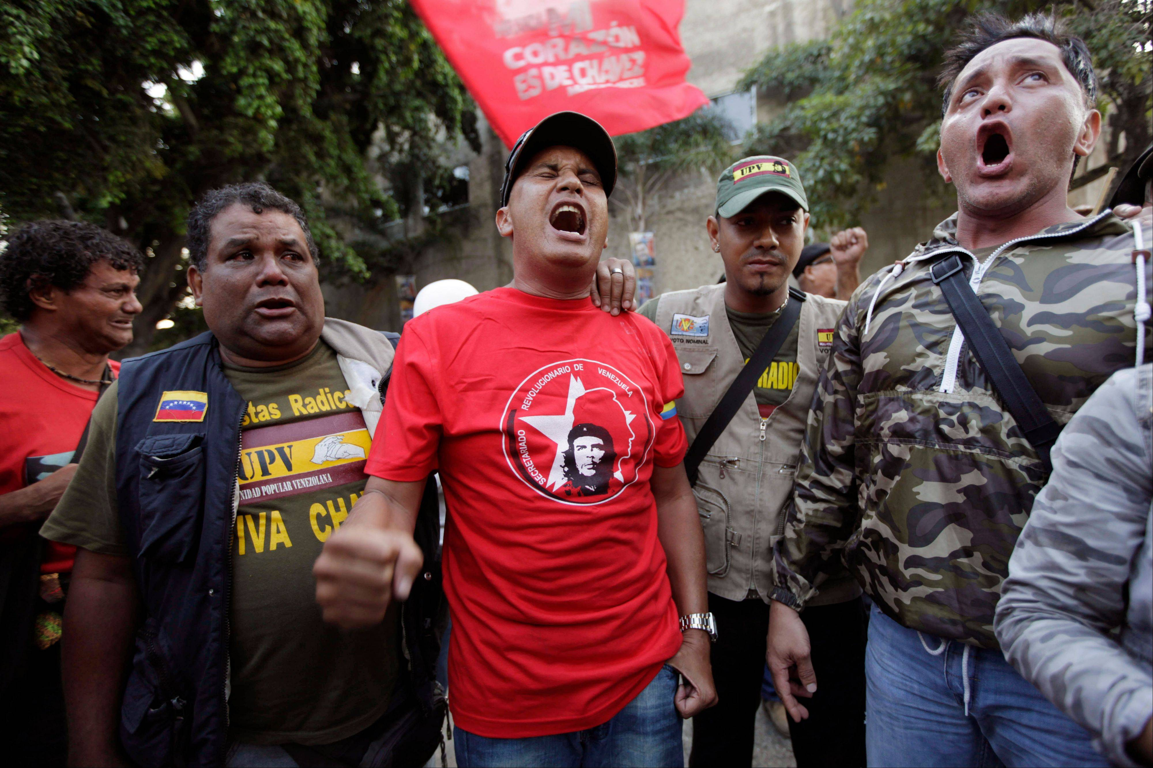 Supporters of Venezuela�s President Hugo Chavez yell �Long Live Chavez!� and sing their nation�s anthem after learning that Chavez has died through an announcement by the vice president in Caracas, Venezuela.