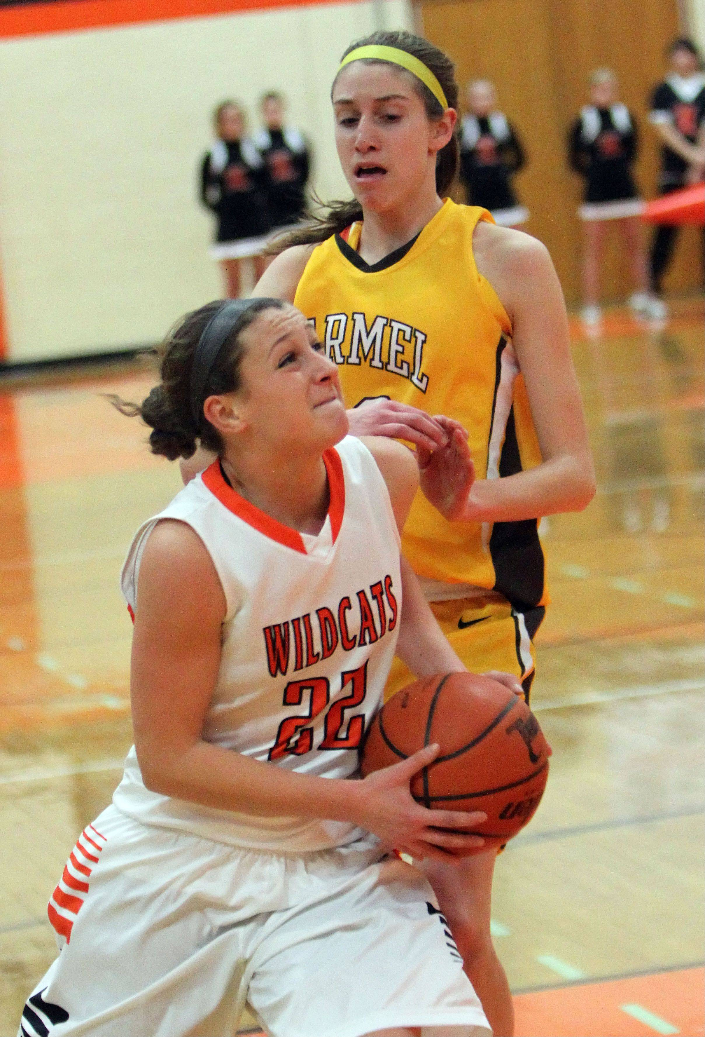 Libertyville�s Olivia Mayer, left, drives on Carmel�s Claire Ogrinc. Mayer has committed to a future in lacrosse and basketball at Augustana.