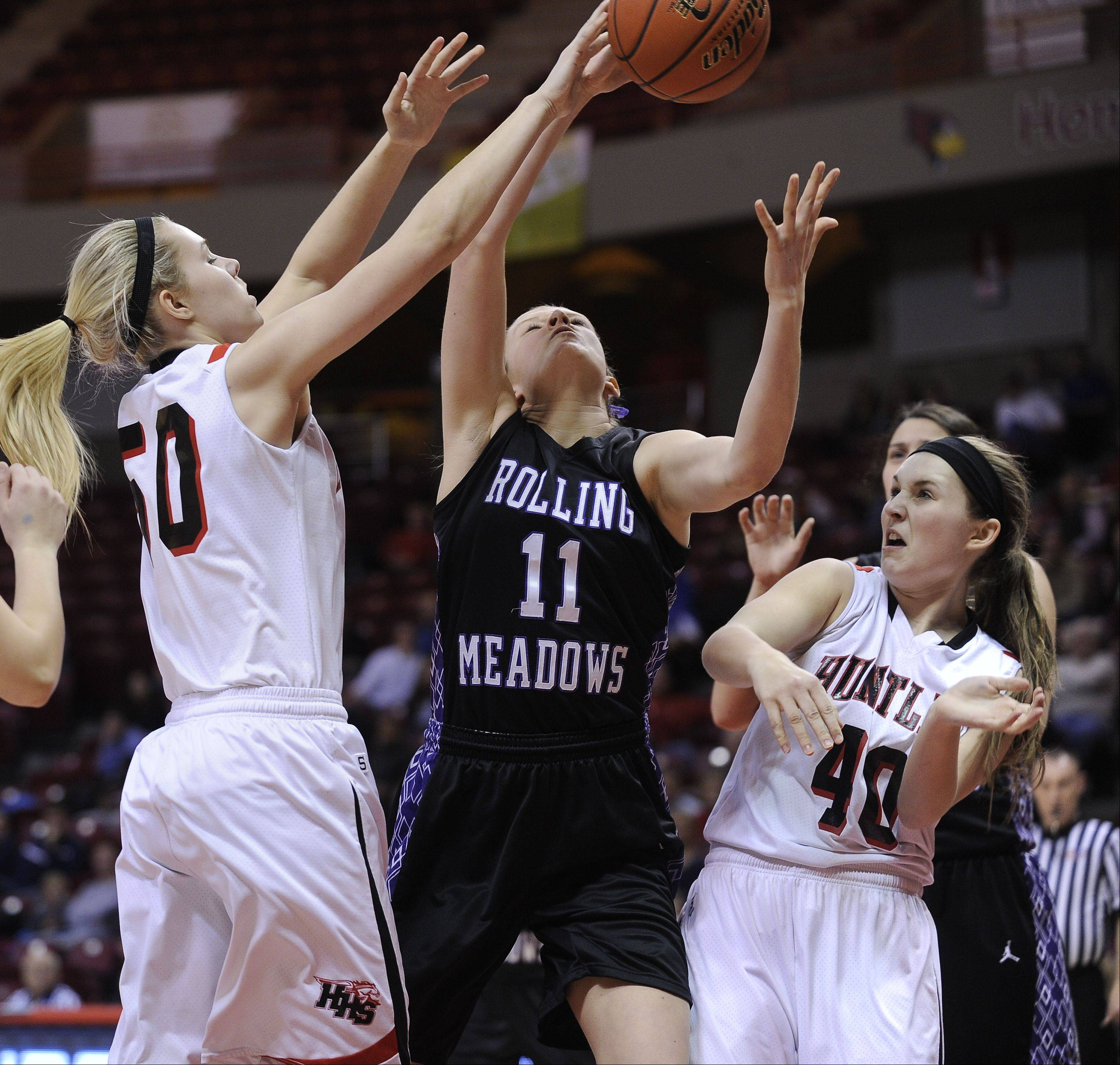 Freshman Ali Andrews, left, and her junior sister Sam, will be back to lead Final Four qualifier Huntley next season.