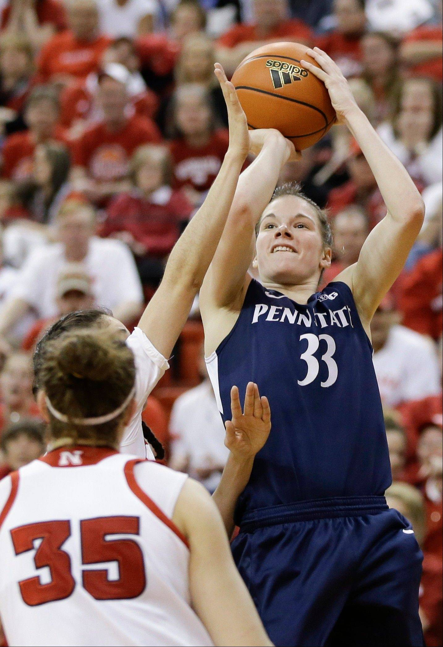 Penn State�s Maggie Lucas (33) shoots over Nebraska�s Rachel Theriot and Jordan Hooper (35) in the first half of an NCAA college basketball game in Lincoln, Neb., Sunday, March 3, 2013. (AP Photo/Nati Harnik)