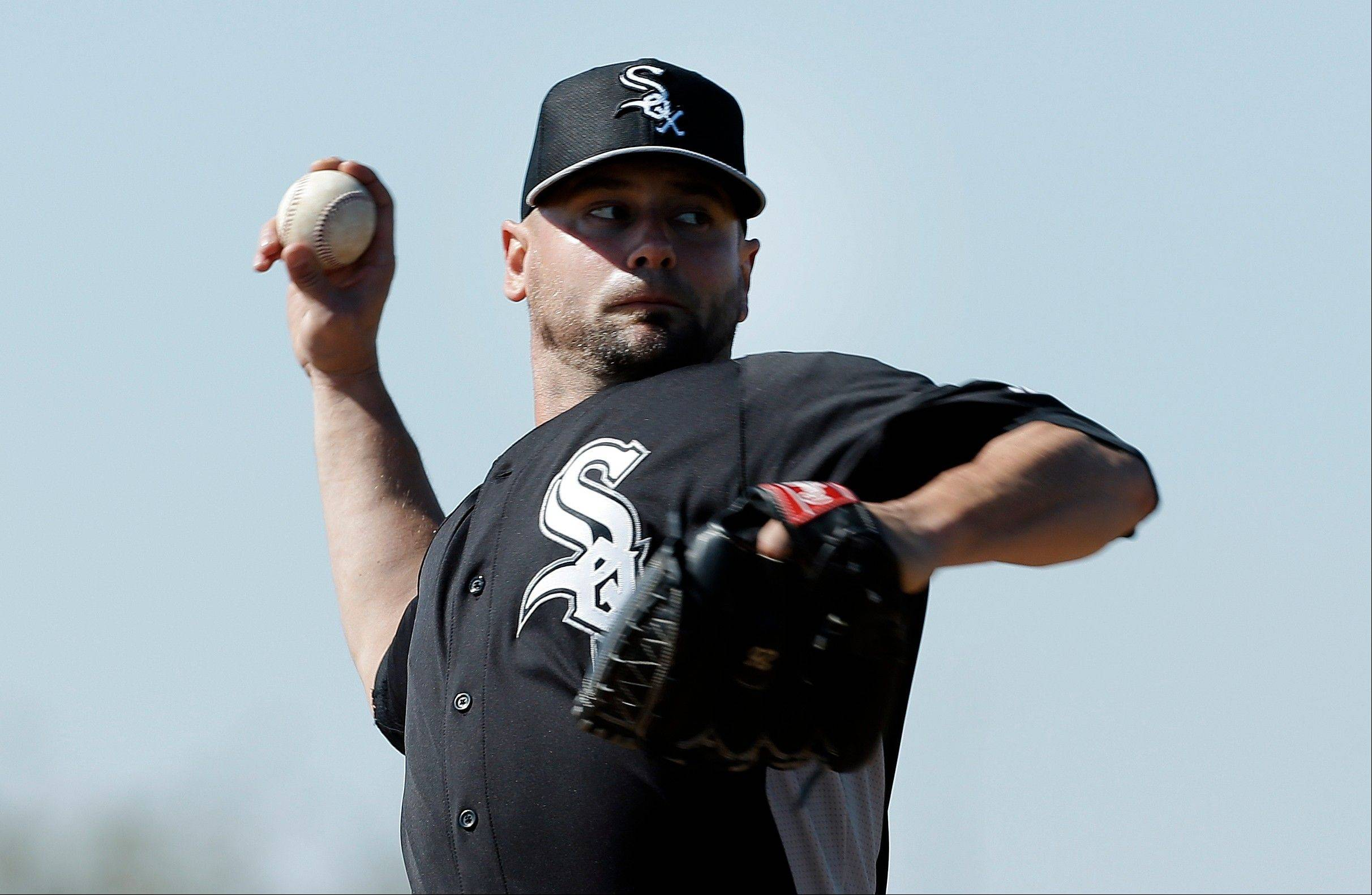 Chicago White Sox pitcher Jesse Crain throws during baseball spring training in Phoenix, Sunday, Feb. 17, 2013. (AP Photo/Paul Sancya)
