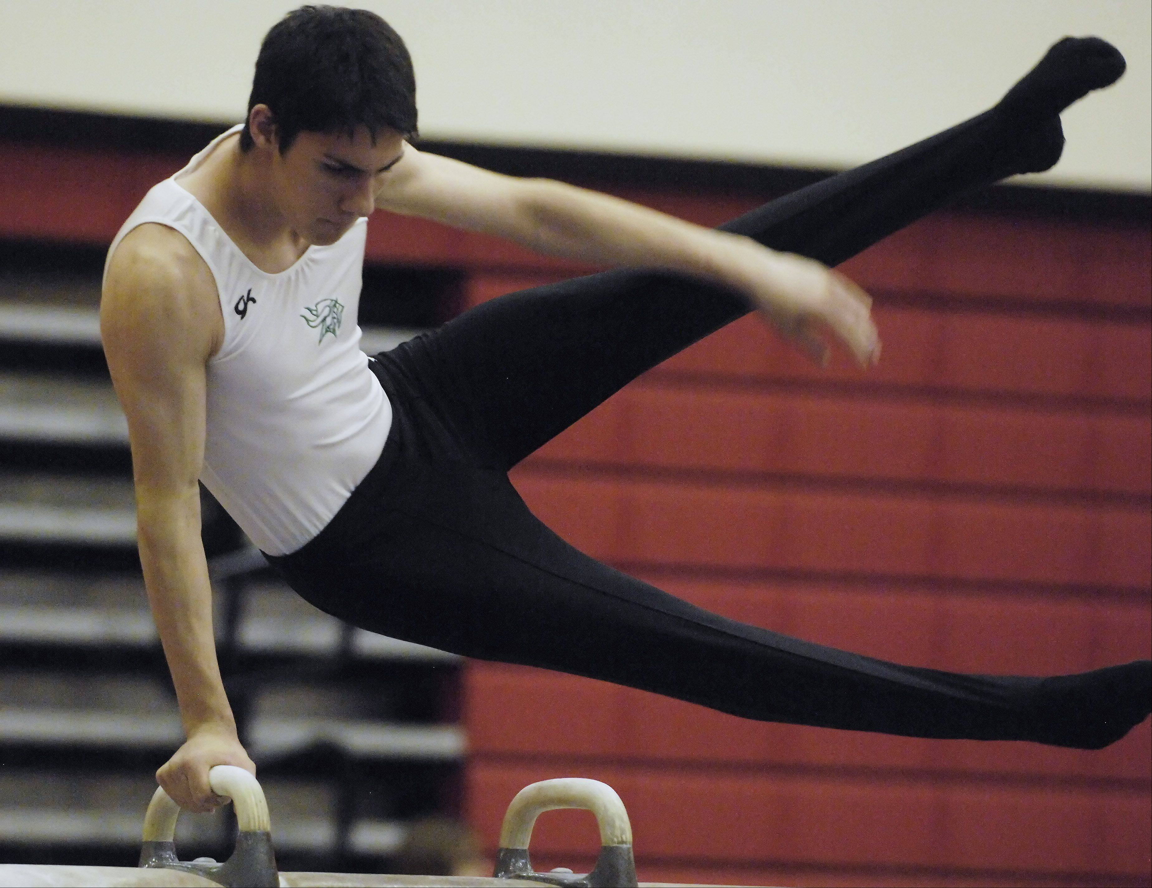 JOE LEWNARD/jlewnard@dailyherald.com � Fremd's C.J. Patton competes on the pommel horse during the Palatine boy's gymnastics sectional meet Saturday.