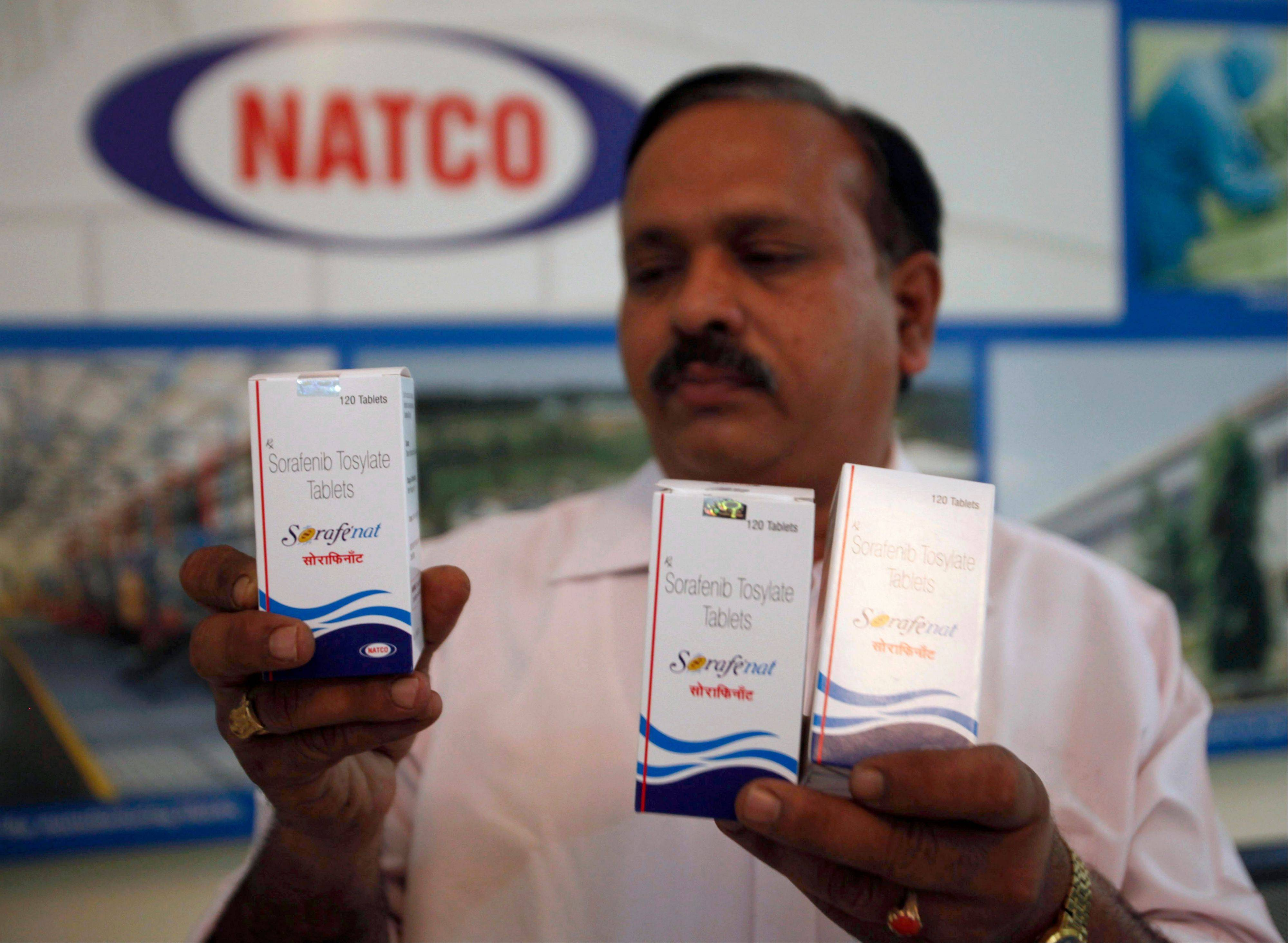 Natco Pharma Ltd. Secretary and General Manager Legal and Corp. Affairs M. Adinarayana displays Sorafenib Tosylate drugs meant for cancer treatment, at the companyís head office in Hyderabad, India. India's patent appeals office.