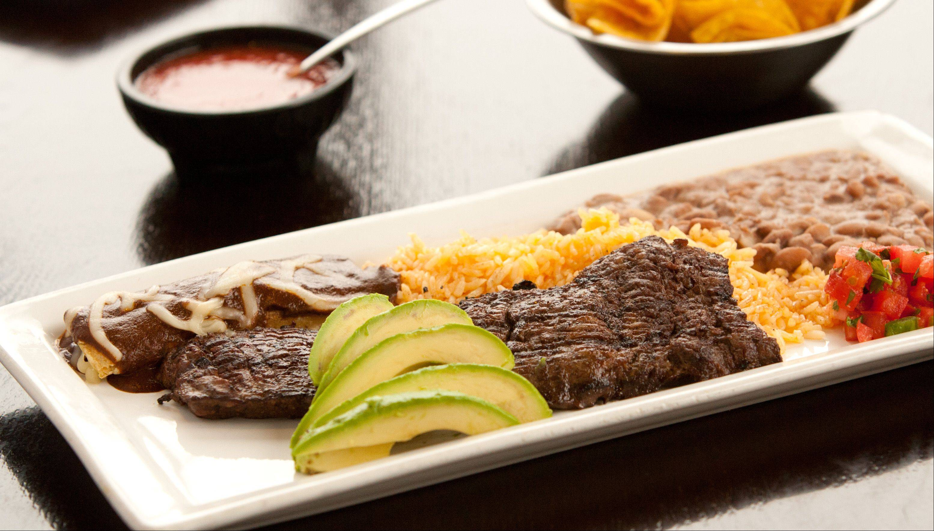 Tampiquena -- grilled skirt steak -- comes with an enchilada on the side at Burrito Parrilla Mexicana in Lombard.