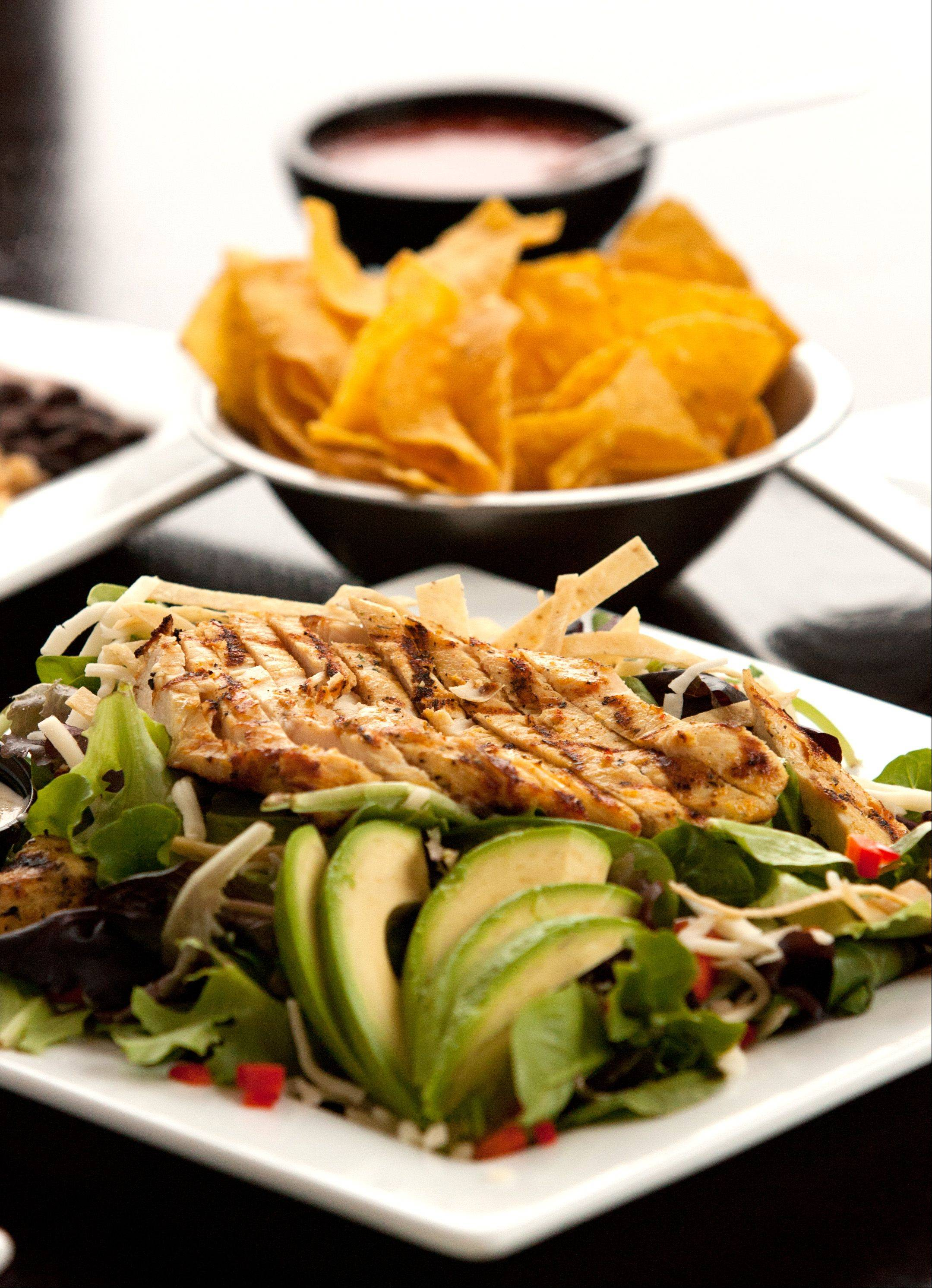Spring greens, Monterey Jack cheese, tortilla strips, red peppers and avocado make up the grilled chicken breast salad at Burrito Parrilla Mexicana in Lombard.