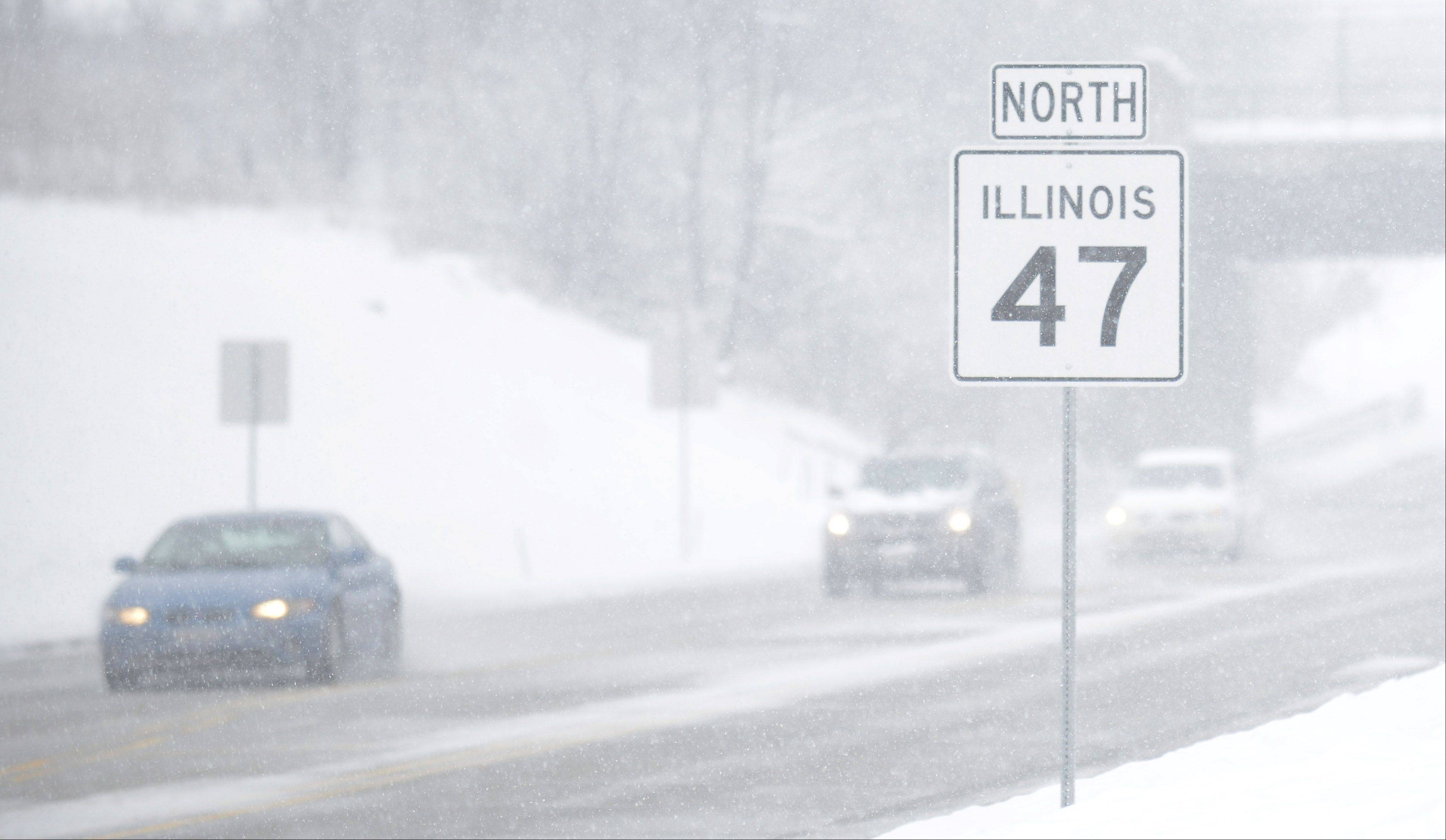 Visibility along Route 47 in Lily Lake is very limited as wet snow continues to fall early in the afternoon Tuesday. Cars without headlights on seemed to almost disappear among the snowflakes.