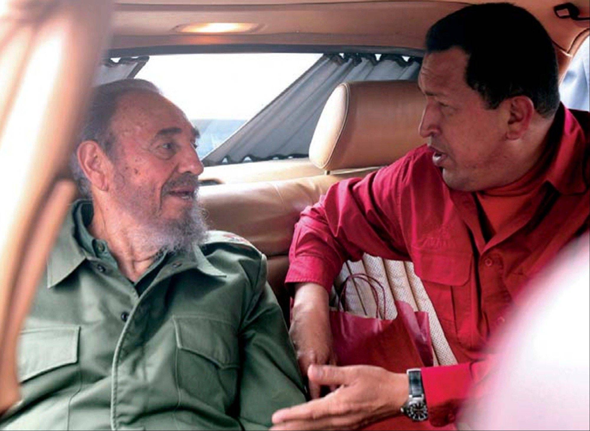 "In this July 22, 2006 photo released by Miraflores Press Office, Venezuela's President Hugo Chavez , right, speak with Cuba's Fidel Castro during their visit to the home of Cuban revolutionary Ernesto ""Che"" Guevara in Cordoba, Argentina."