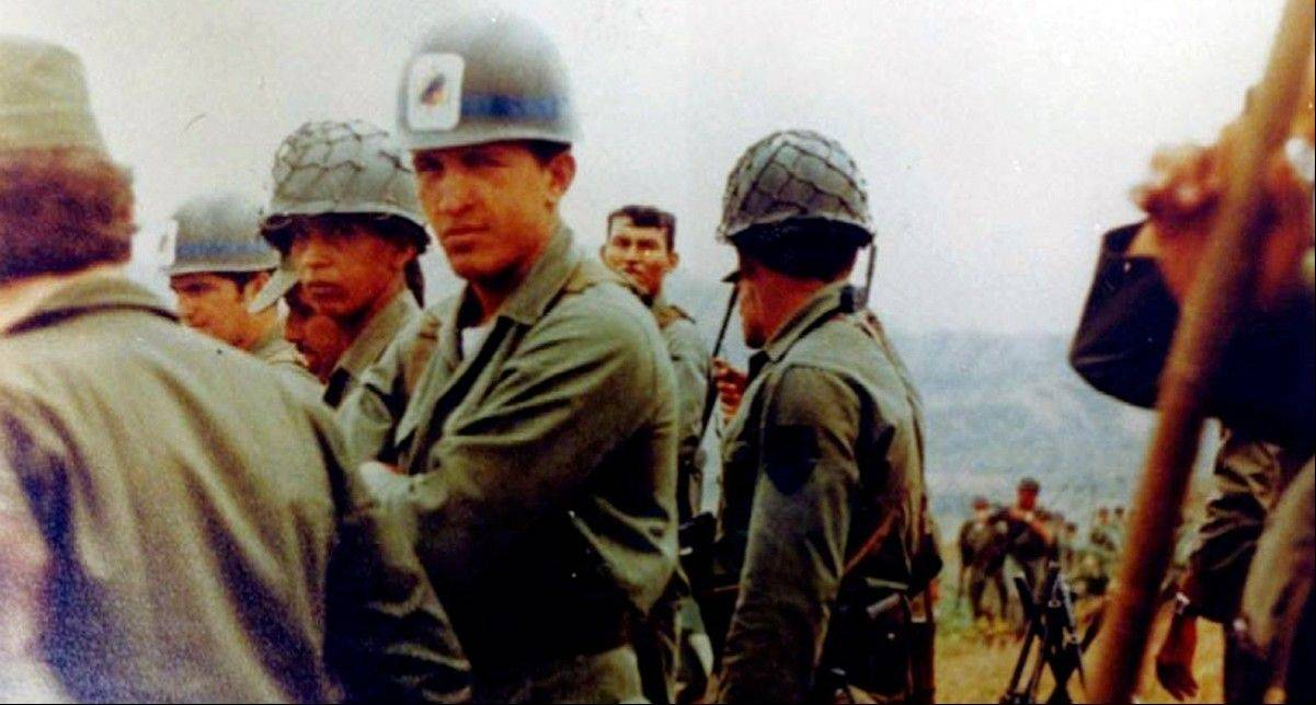 In this undated photo released by Miraflores Press Office, Hugo Chavez, center, looks at the camera during a military exercise in Venezuela.