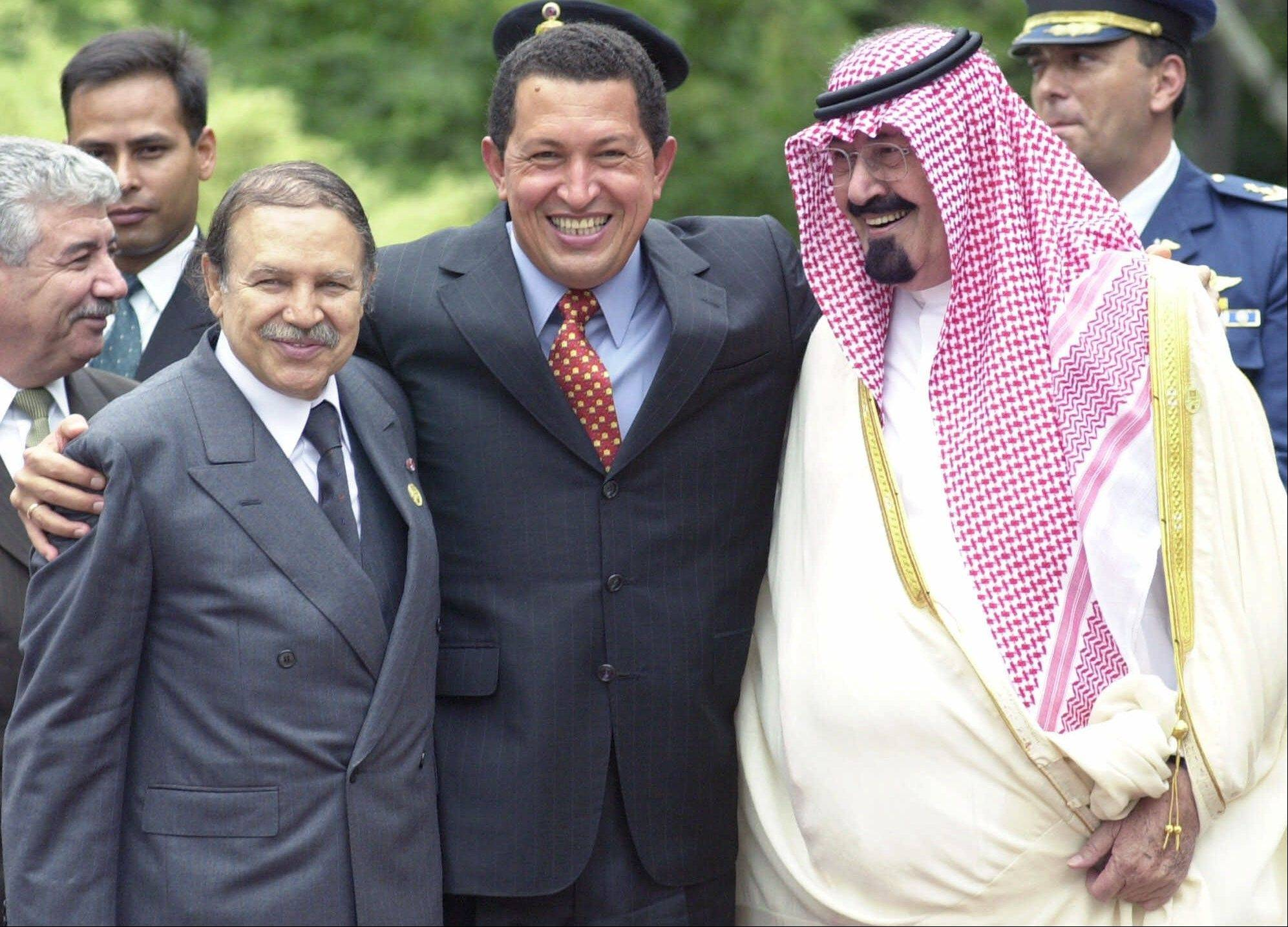 In this Sept. 28, 2000 file photo, Venezuela's President Hugo Chavez, center, Algeria's President Abdelaziz Bouteflika, left, and Saudi Arabian Crown Prince Abdullah Bin Abdulaziz Al Saud joke after posing for an official photograph on the final day of the second summit of the Organization of Petroleum Exporting Countries (OPEC) in Caracas, Venezuela.