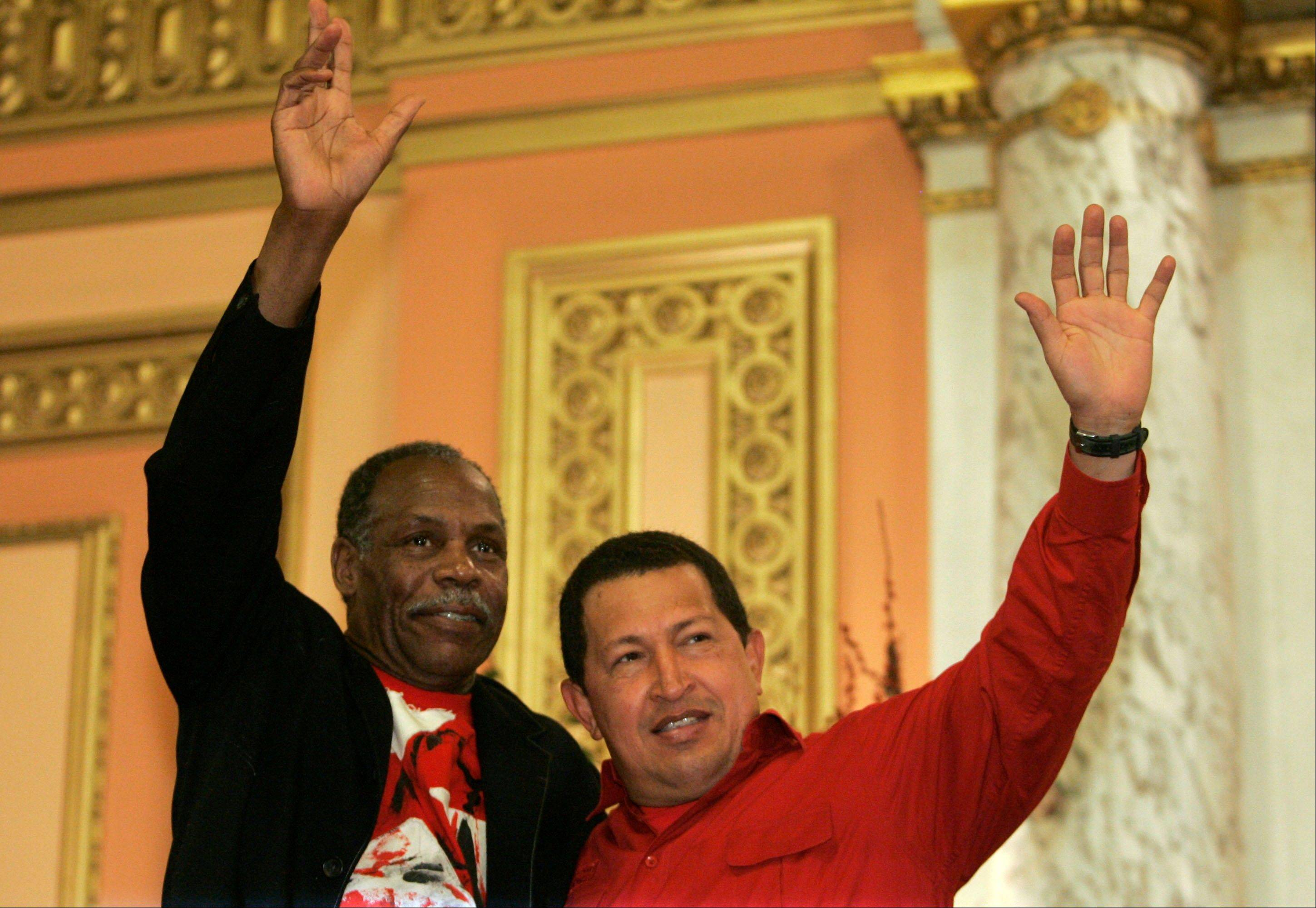 In this Sept. 21, 2006, file photo, Venezuela's President Hugo Chavez, right, and U.S. actor Danny Glover wave to a crowd gathered at the Mount Olive Baptist Church in the Harlem neighborhood of New York.