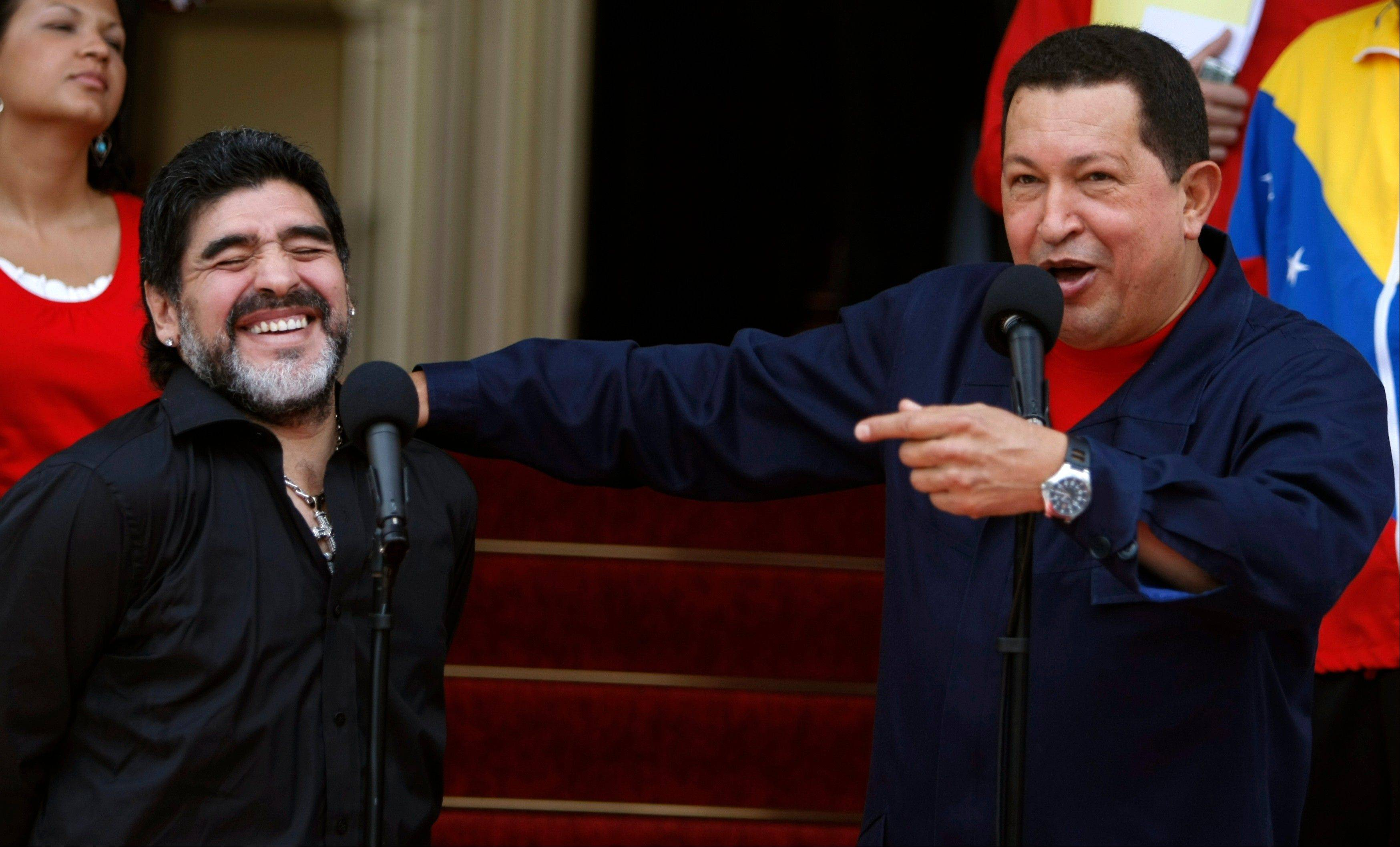 In this July 22, 2010, file photo, Venezuela's President Hugo Chavez, right, speaks next to Argentina's national soccer team coach Diego Armando Maradona upon Maradona's arrival to Miraflores presidential palace in Caracas, Venezuela.