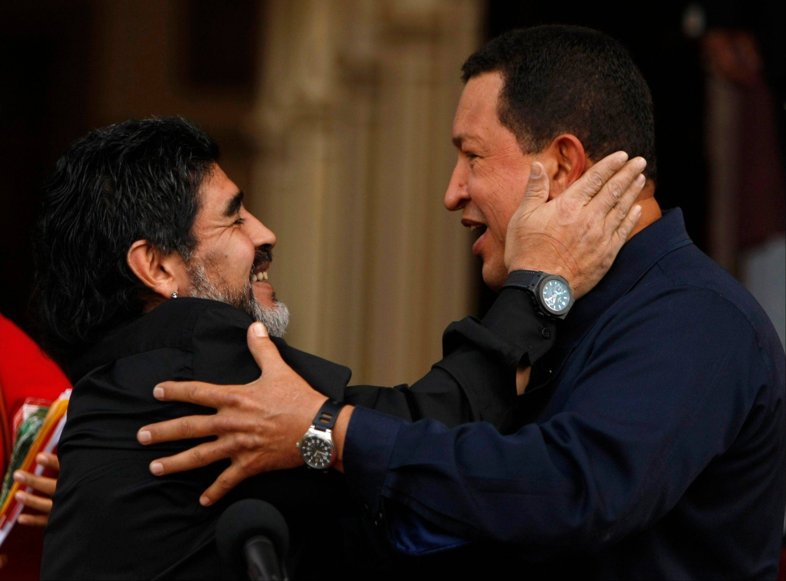 In this July 22, 2010, file photo, Venezuela's President Hugo Chavez, right, and Argentina's national soccer team coach Diego Armando Maradona embrace upon Maradona's arrival to Miraflores presidential palace in Caracas, Venezuela.