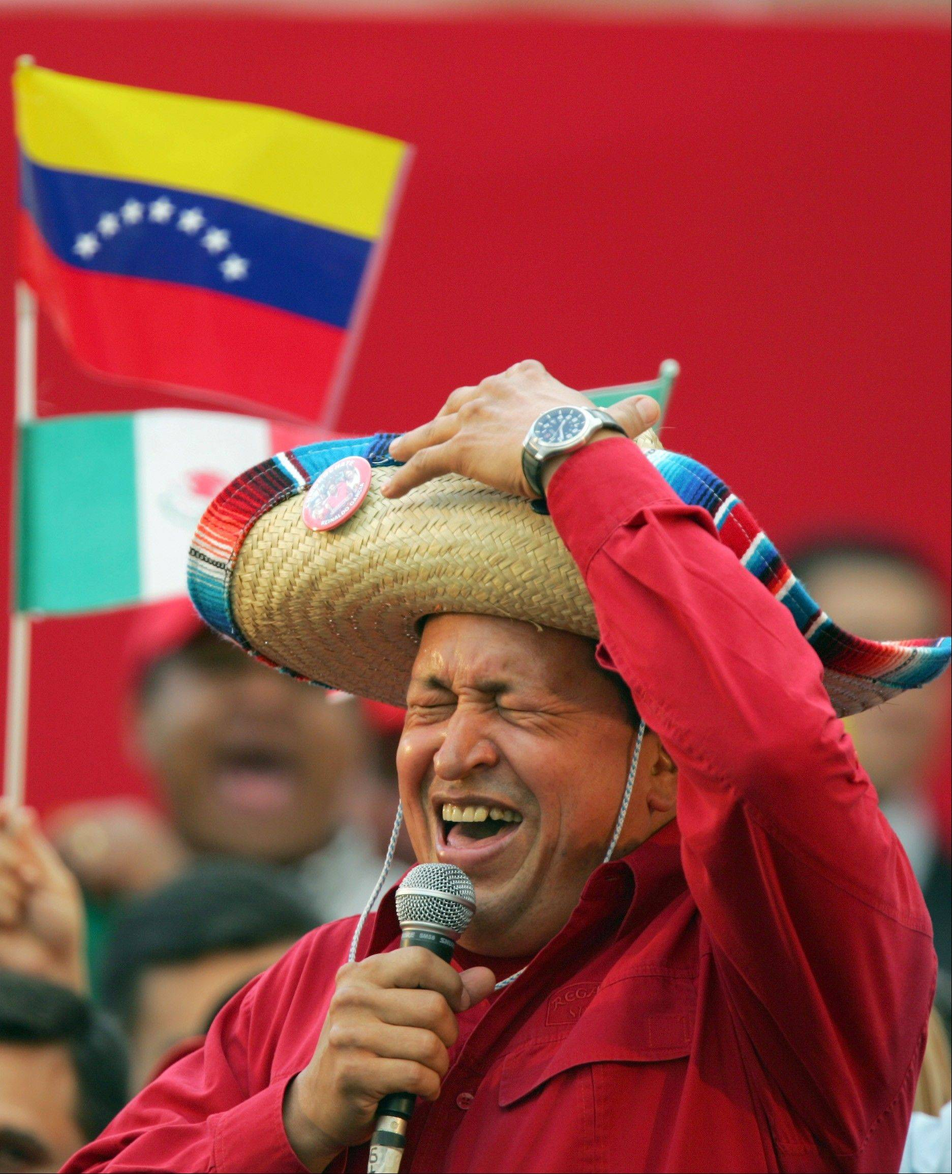 In this Nov. 19, 2005 file photo, Venezuela's President Hugo Chavez wears a Mexican sombrero as he sings a Mexican ranchera song at a rally in Caracas, Venezuela.