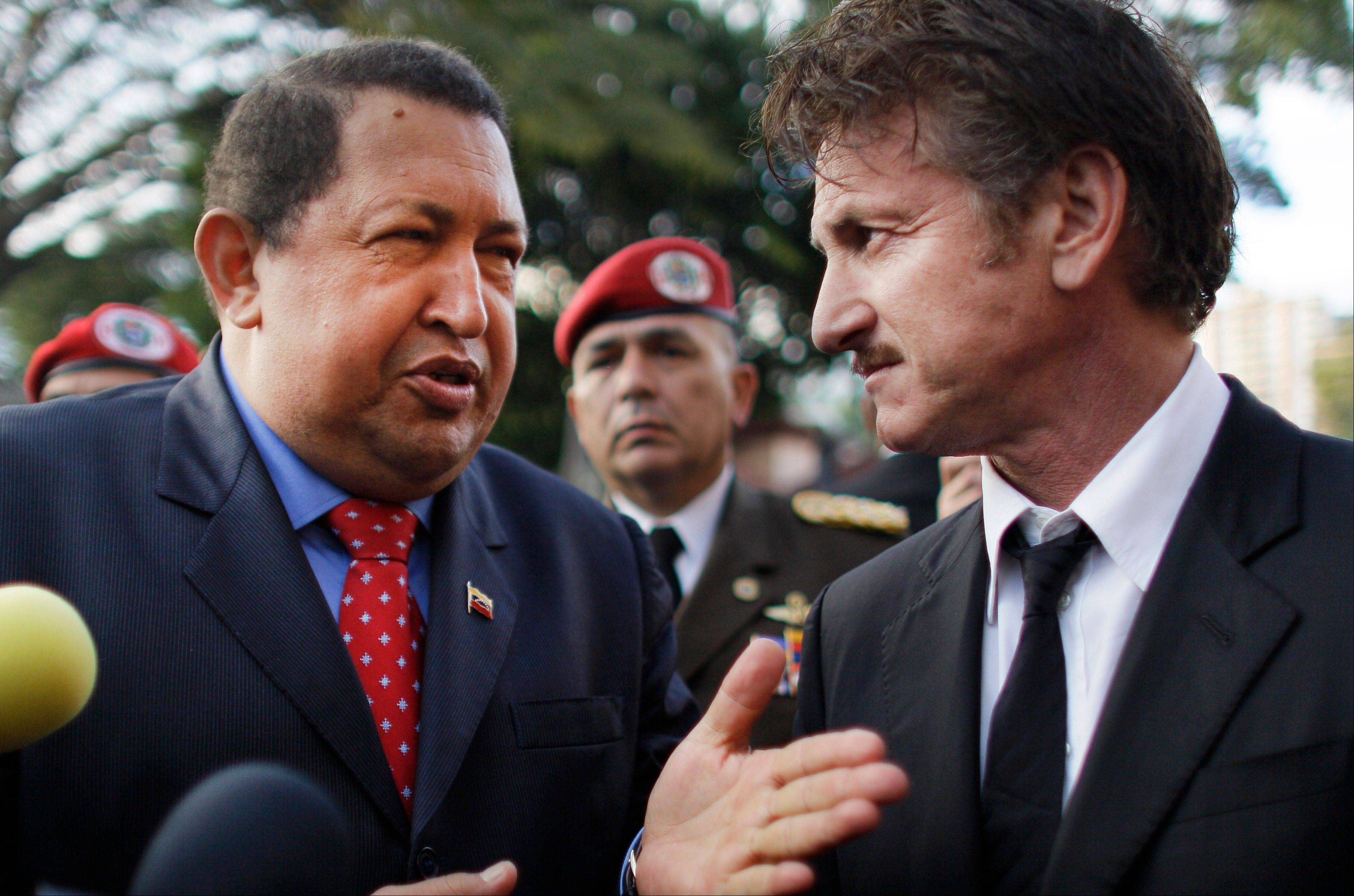 In this Thursday, Feb. 16, 2012 file photo Venezuela's President Hugo Chavez, left, talks to US actor Sean Penn at the presidential palace in Caracas, Venezuela.