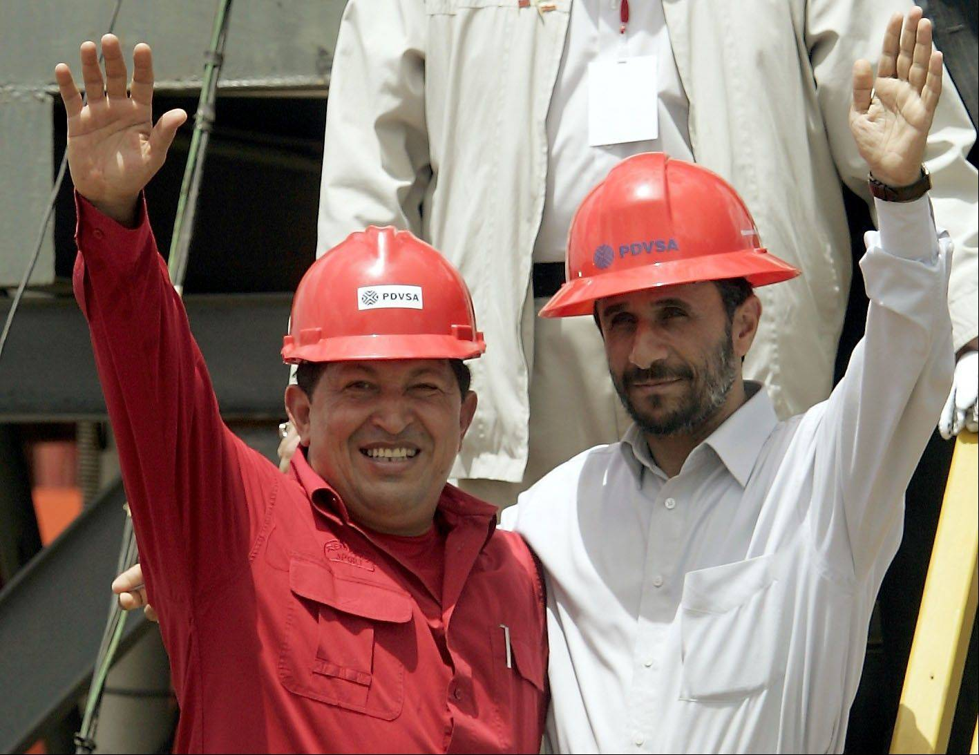 In this Sept. 18, 2006 file photo, Venezuela's President Hugo Chavez, left, and Iran's President Mahmoud Ahmadinejad wave to the press after inaugurating an oil drill in San Tome, Venezuela.