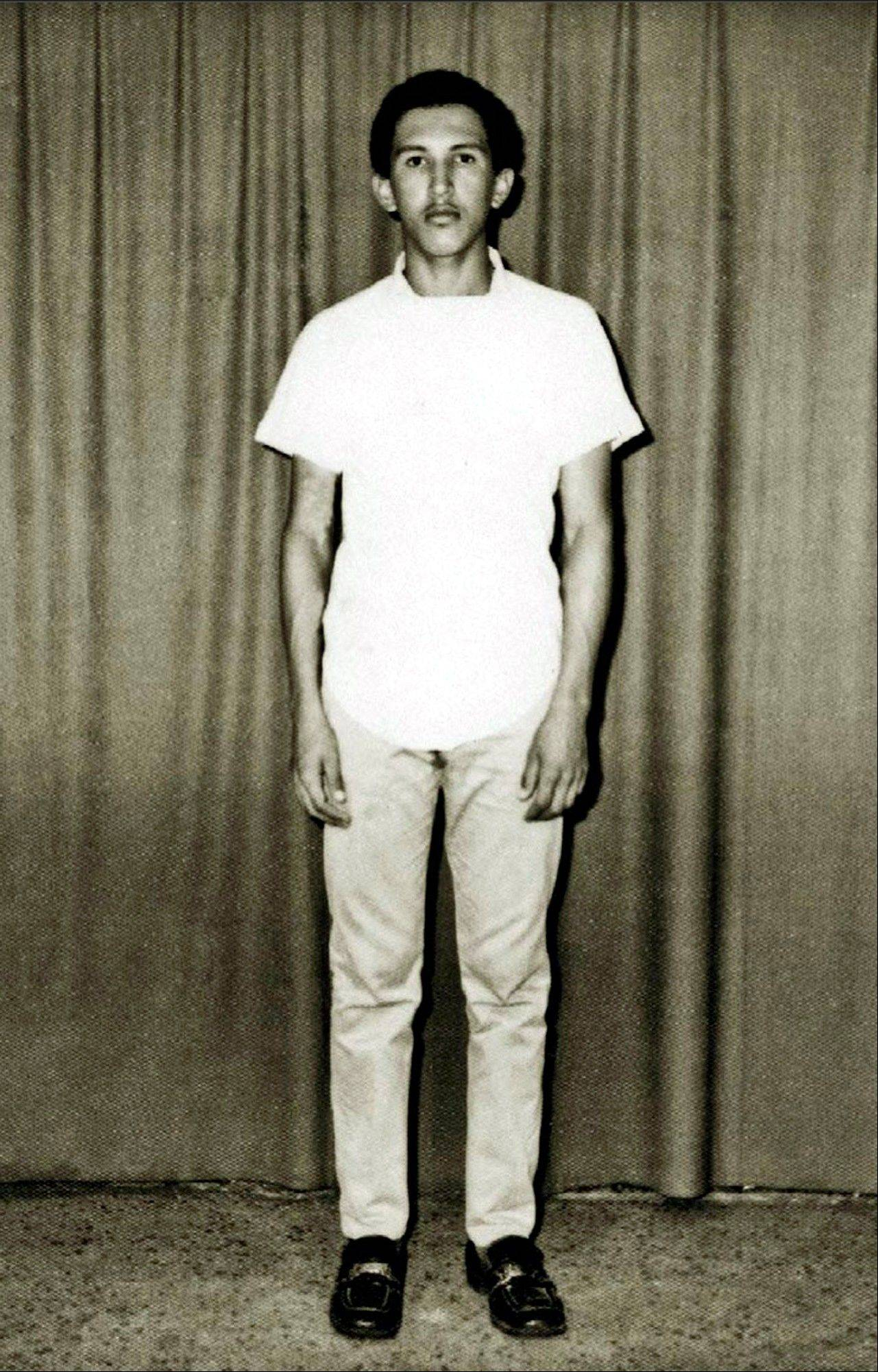 In this March 1971 photo released by Miraflores Press Office, Hugo Chavez poses for a photo prior to his admission to the military academy in Caracas, Venezuela.