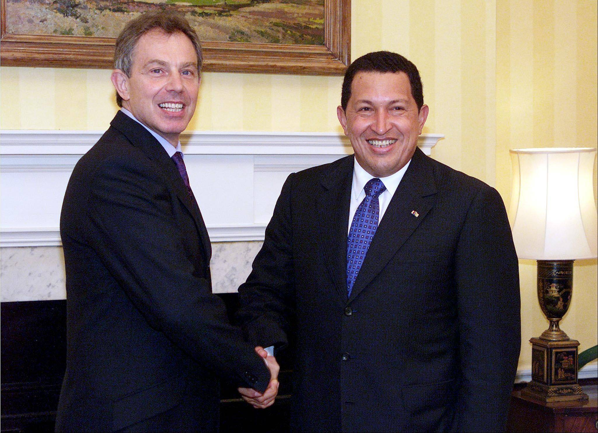 In this Oct. 23, 2001 file photo, Venezuela's President Hugo Chavez, right, is greeted by British Prime Minister Tony Blair at Blair's No.10 Downing Street residence in London.