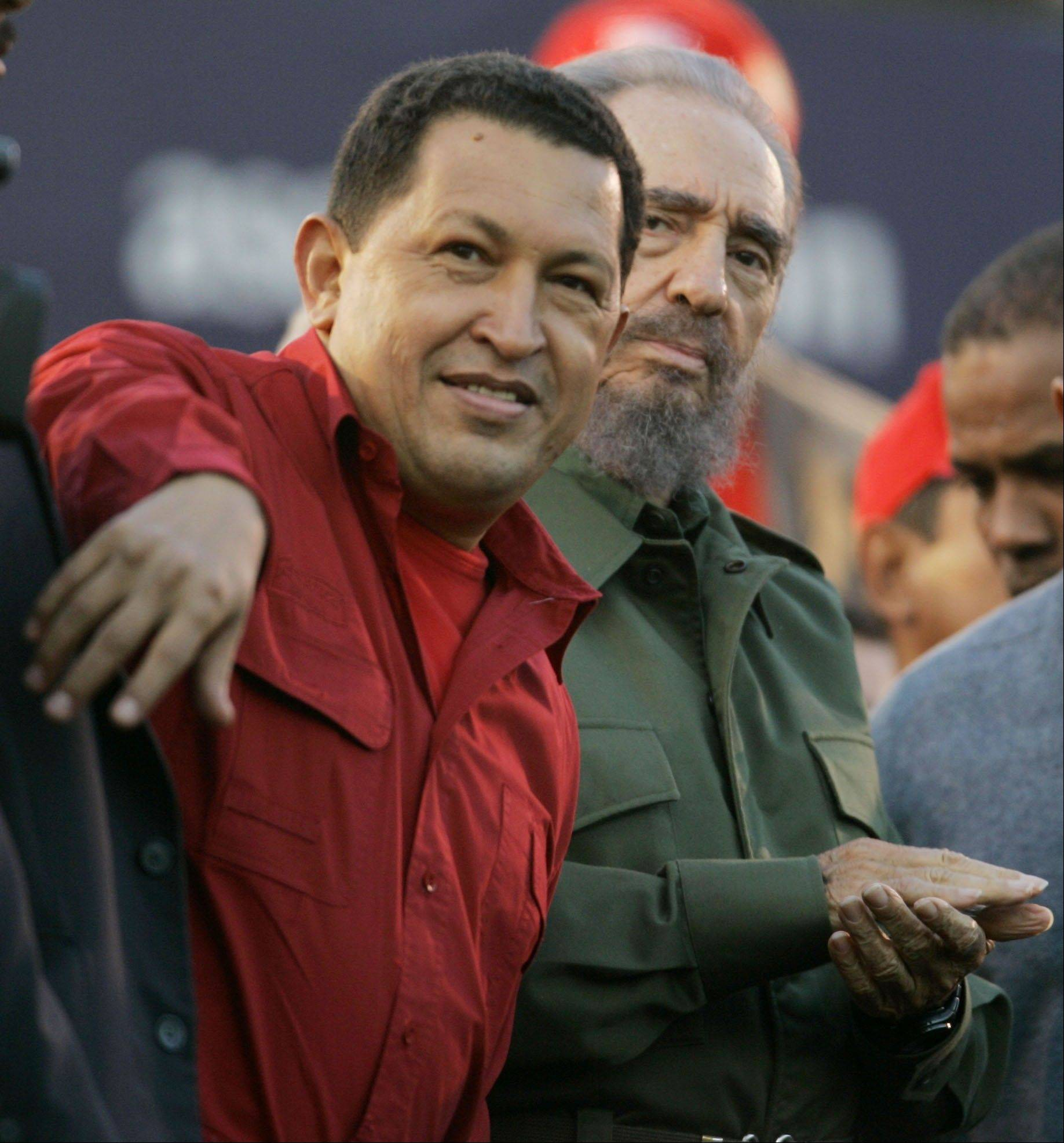 In this July 21, 2006 file photo, Venezuela's President Hugo Chavez, left, gestures as Cuba's President Fidel Castro looks on during an event in Cordoba, Argentina.