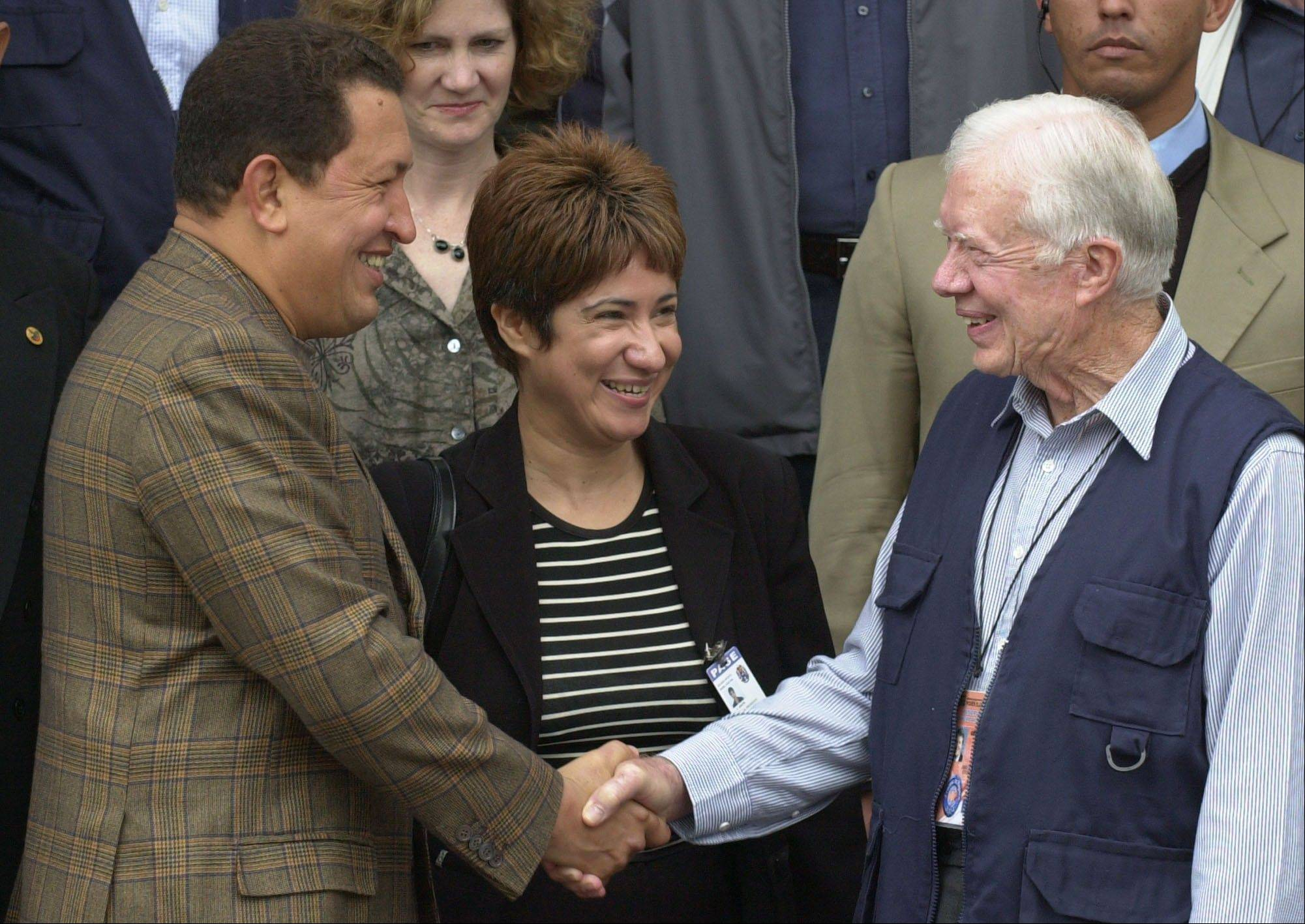 In this May 30, 2004 file photo, Venezuela's President Hugo Chavez, left, shakes hands with former U.S. President Jimmy Carter at Miraflores presidential palace palace in Caracas, Venezuela.