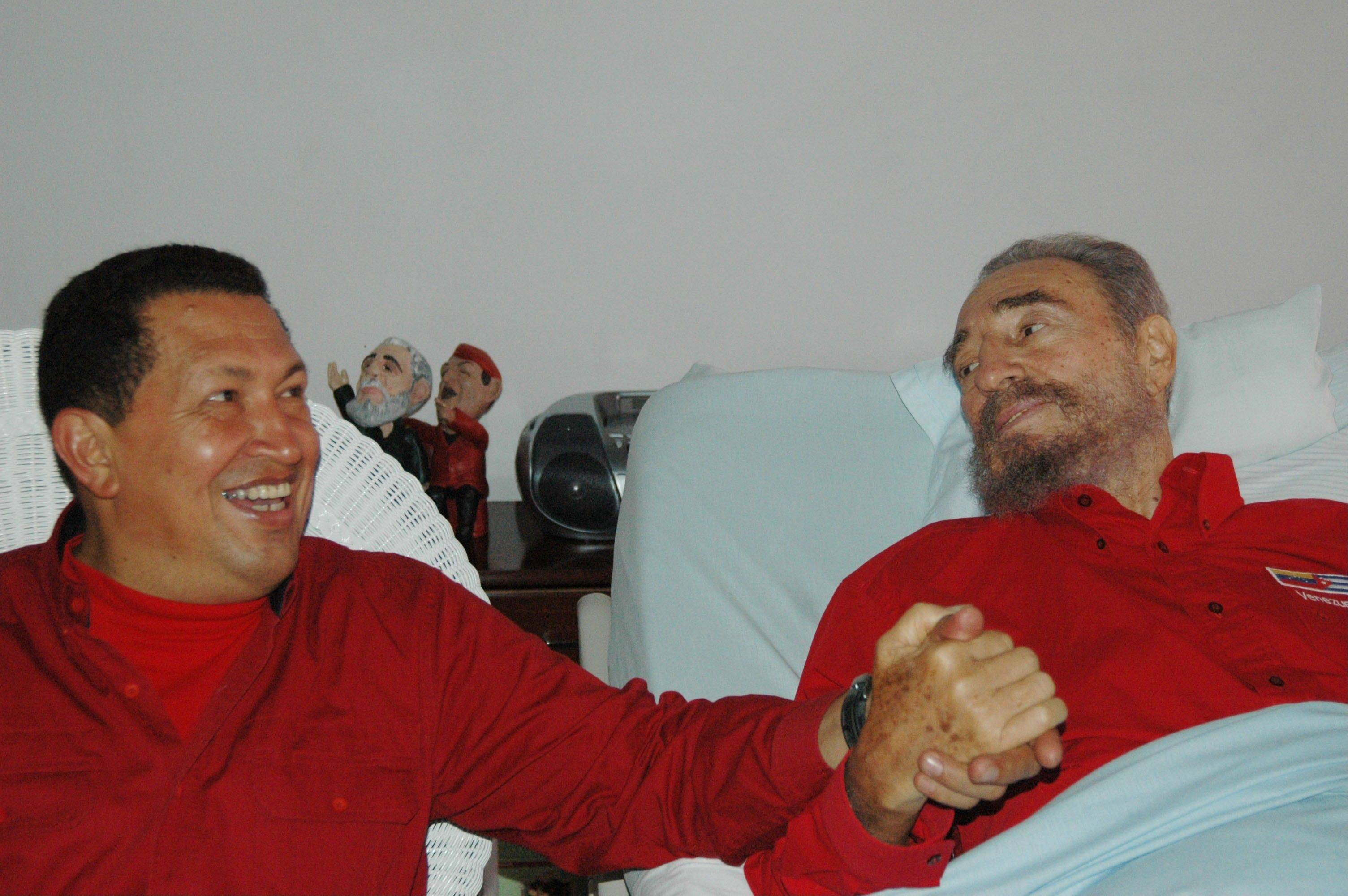 In this Aug. 13, 2006 file photo released by Cuba's Communist daily newspaper Granma, Cuba's leader Fidel Castro, right, and Venezuela's President Hugo Chavez hold hands as Castro recuperates from surgery in Havana, Cuba.