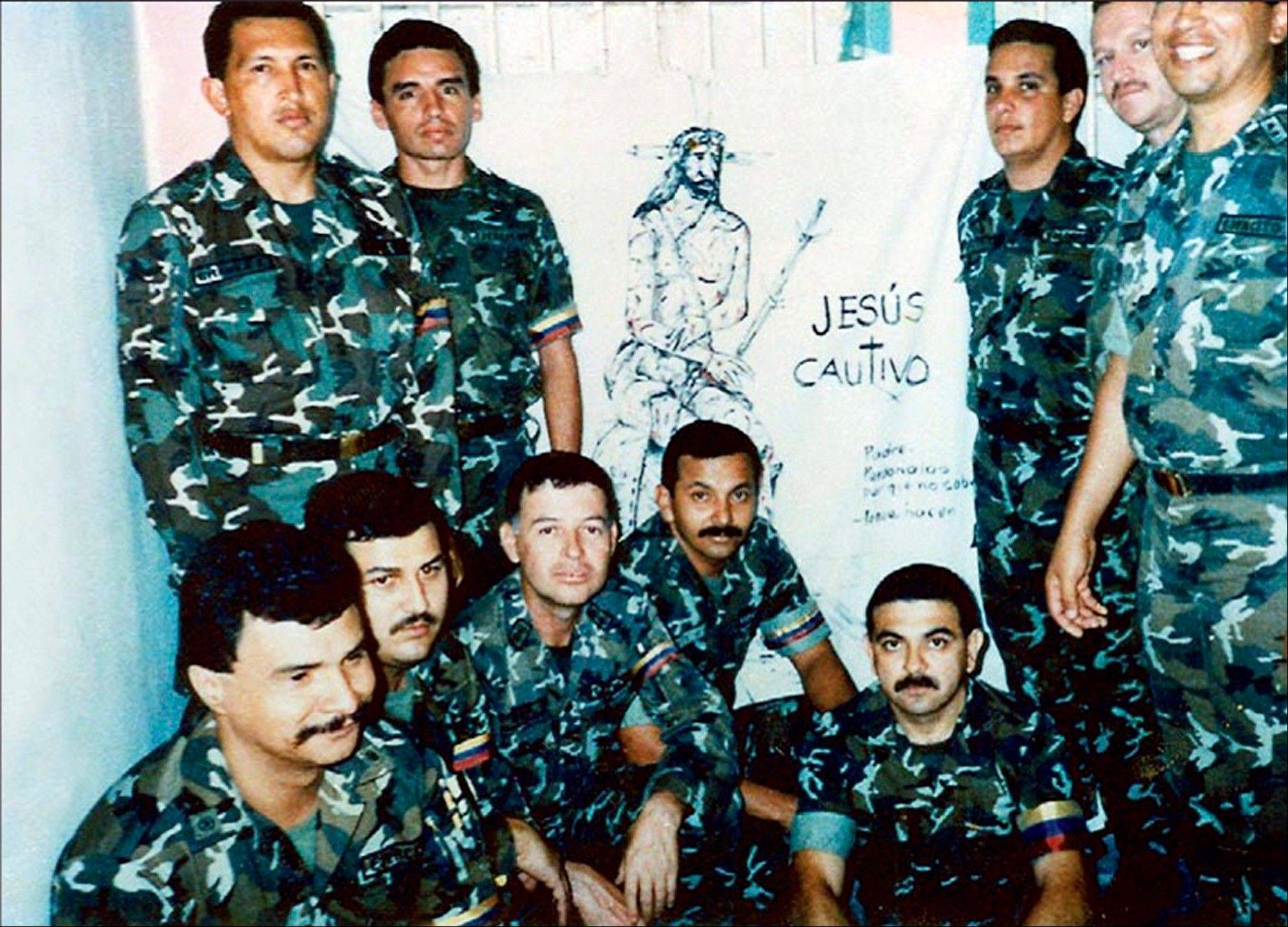 In this photo released by Miraflores Press Office, Hugo Chavez, top left, poses with fellow members of the failed coup as they serve time in Yare II jail near Caracas, Venezuela.