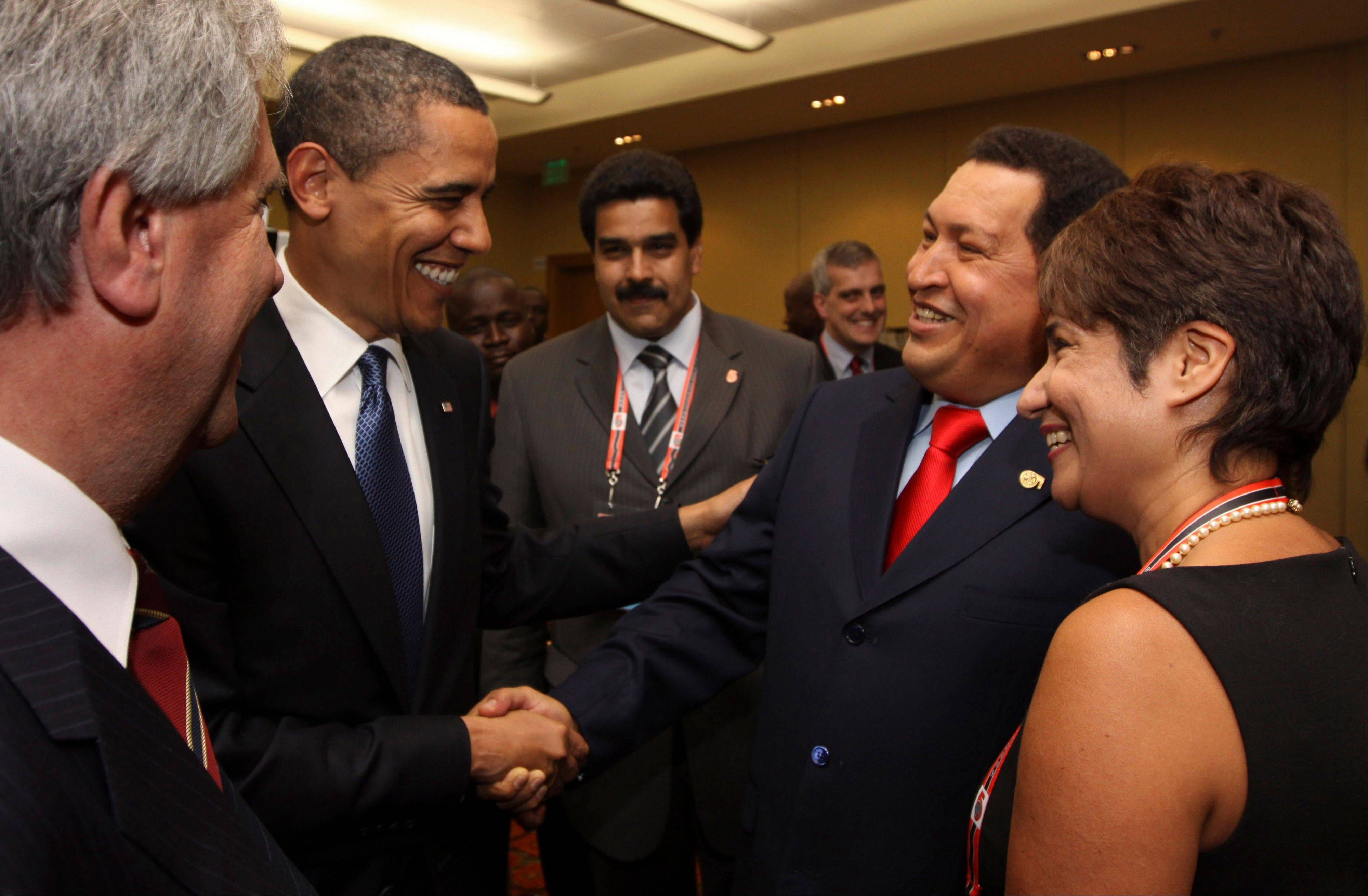 In this April 17, 2009 file photo, President Barack Obama, left, shakes hands with Venezuela's President Hugo Chavez before the opening session of the 5th Summit of the Americas in Port of Spain, Trinidad and Tobago.