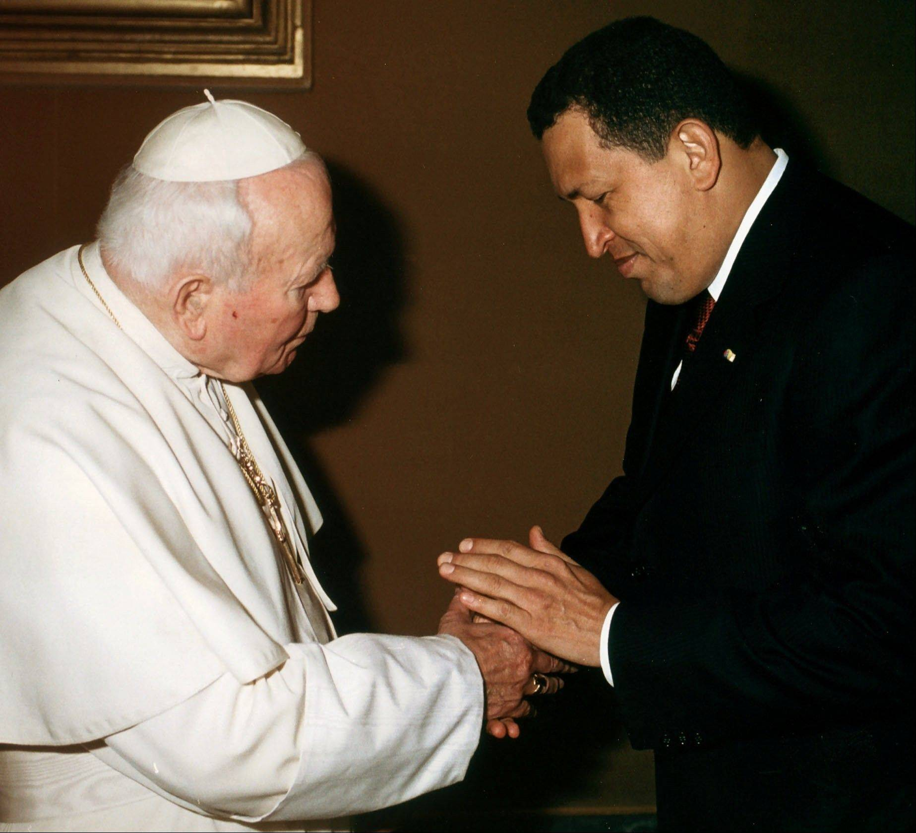In this Oct. 12, 2001 file photo released by the Vatican, Pope John Paul II shakes hands with Venezuela's President Hugo Chavez during a private audience at the Vatican City .