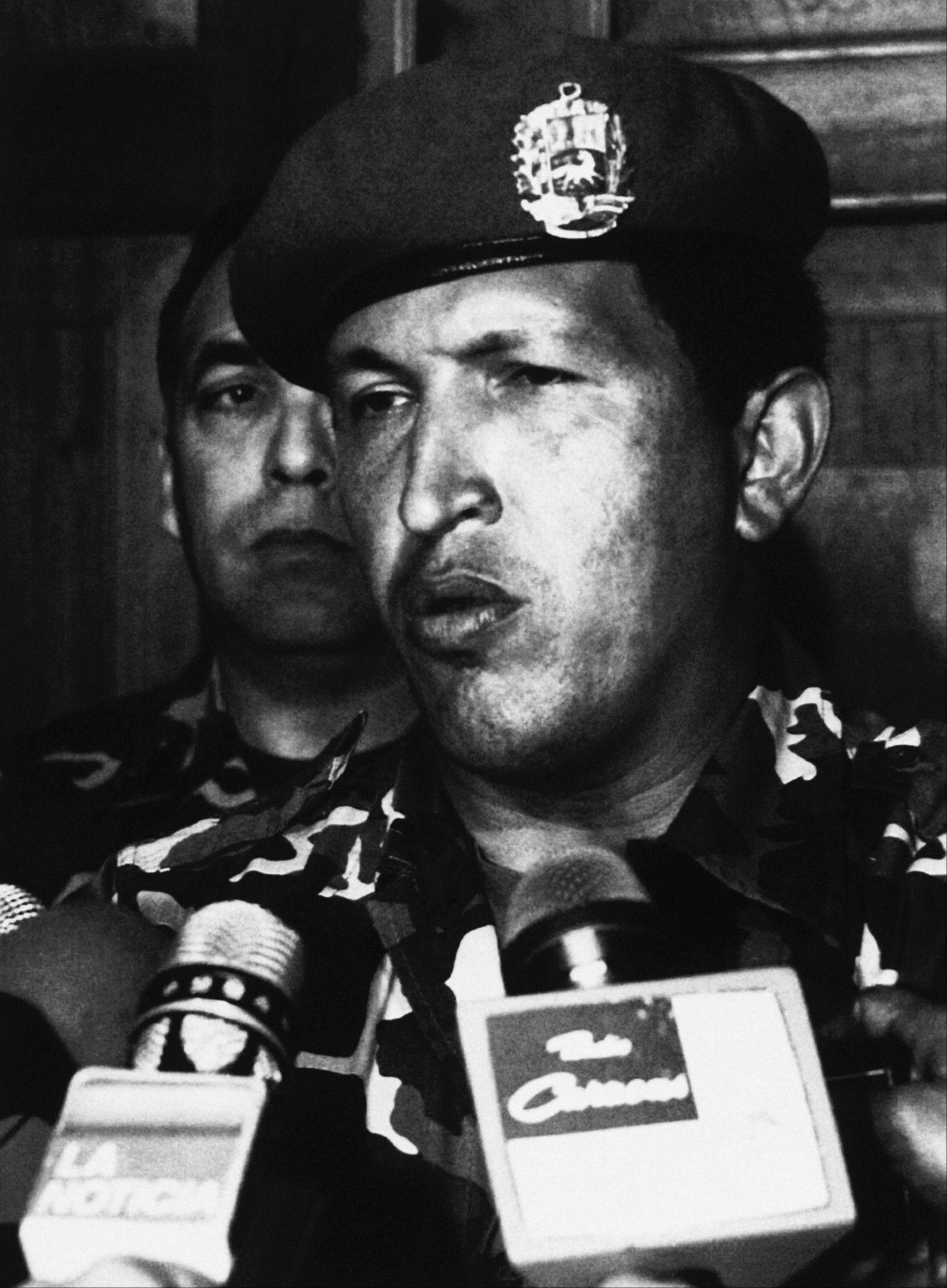 In this Feb. 4, 1992 file photo, paratroop commander Hugo Chavez talks to reporters at the Defense Ministry after he surrendered to the troops loyal to the government of Carlos Andres Perez in Caracas, Venezuela. Chavaz surrendered in the western city of Valencia and was transported to Caracas, where he called his followers to give up their arms.