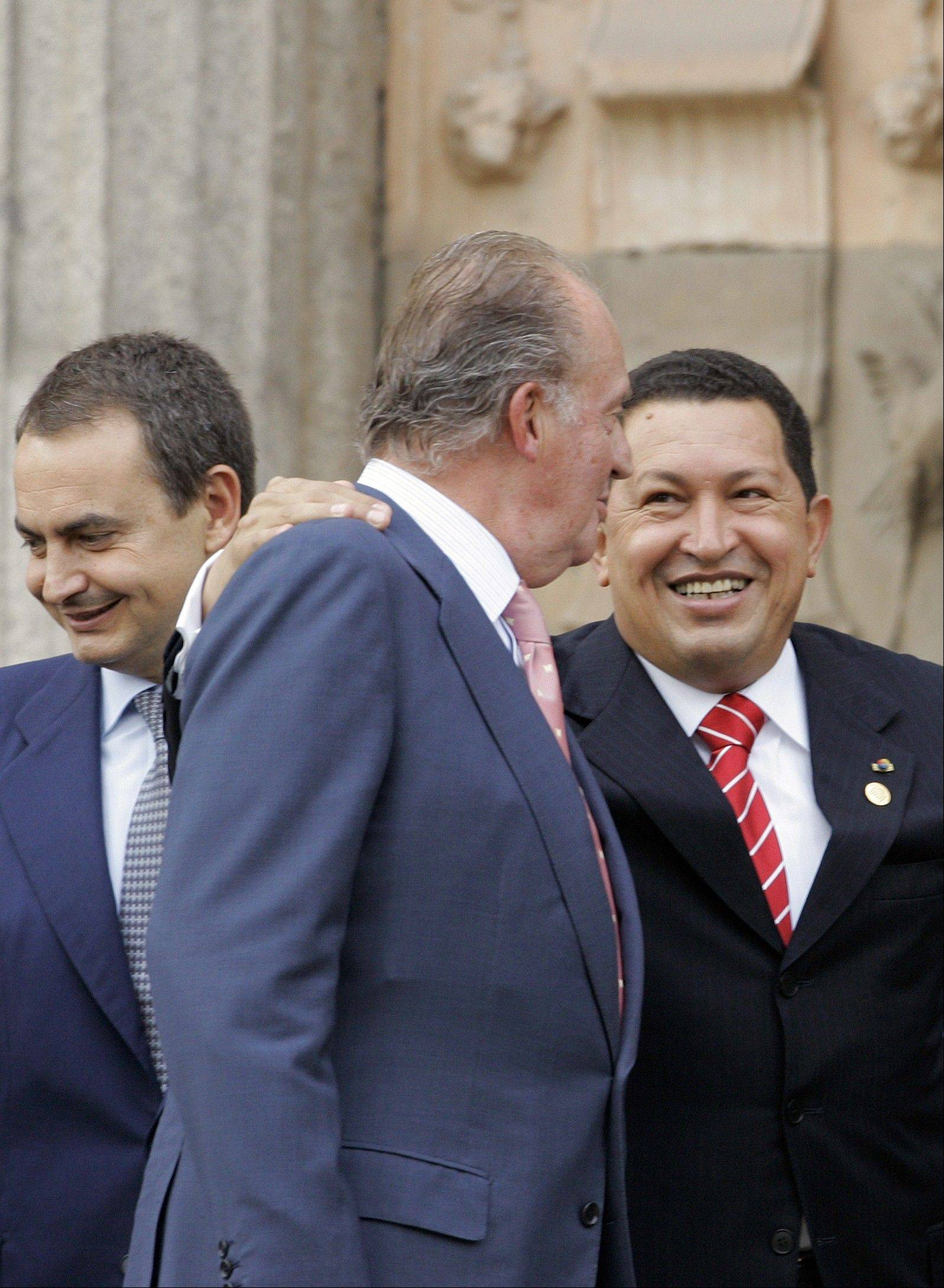 In this Oct. 14, 2005 file photo, Venezuela's President Hugo Chavez, right, talks with Spain's King Juan Carlos, center, as Spain's Prime Minister Jose Luis Rodriguez Zapatero stands at left in Salamanca, Spain.