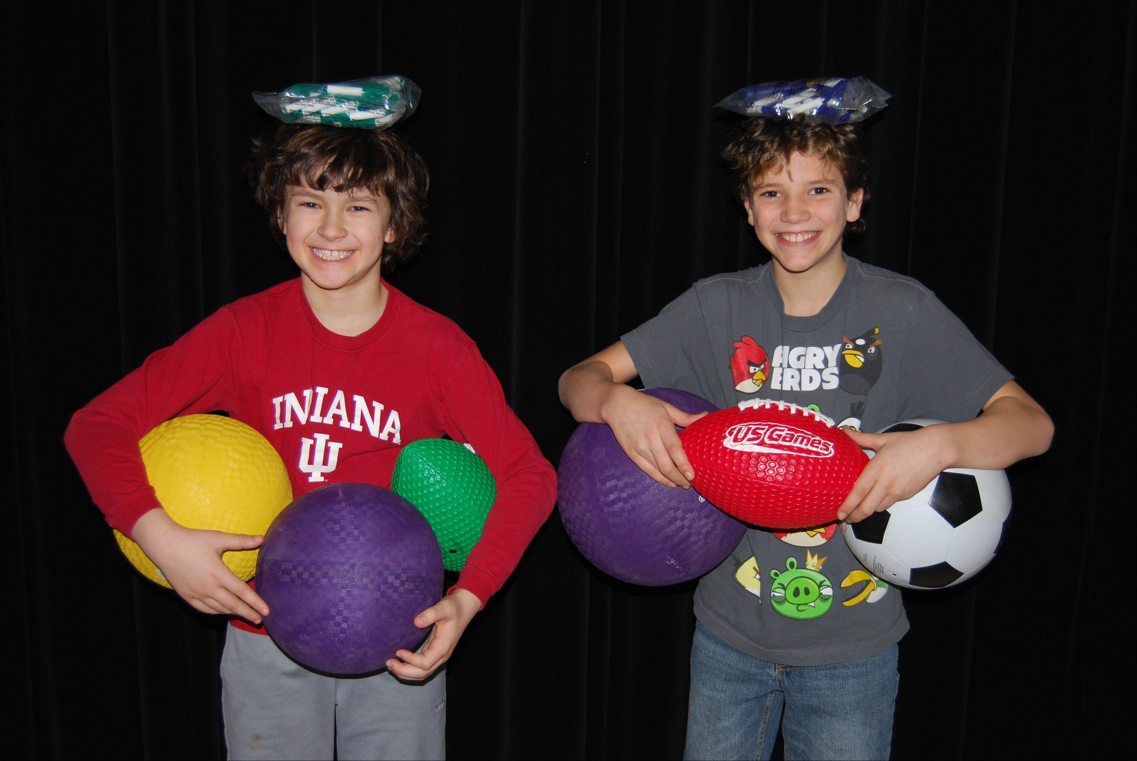 Two Central Road Elementary students show a small portion of the many playground balls and jump ropes purchased with the grant money obtained by the Central Road School PTA as part of the national organization's PTA Take Your Family to School Week.