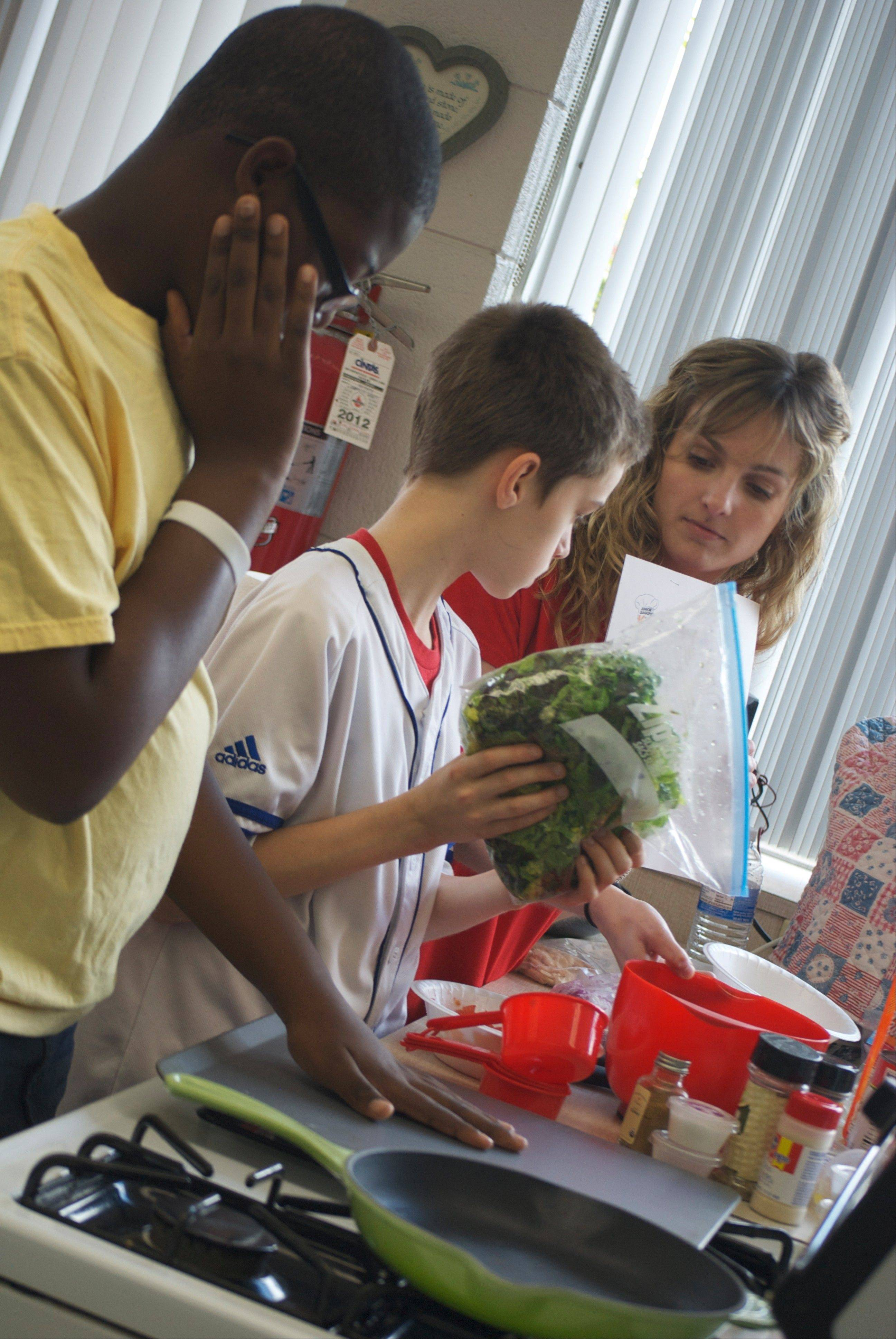 Through the annual Kids in the Kitchen program, the Junior League of Kane and DuPage Counties teaches kids about nutrition and how to make healthy meals and snacks.