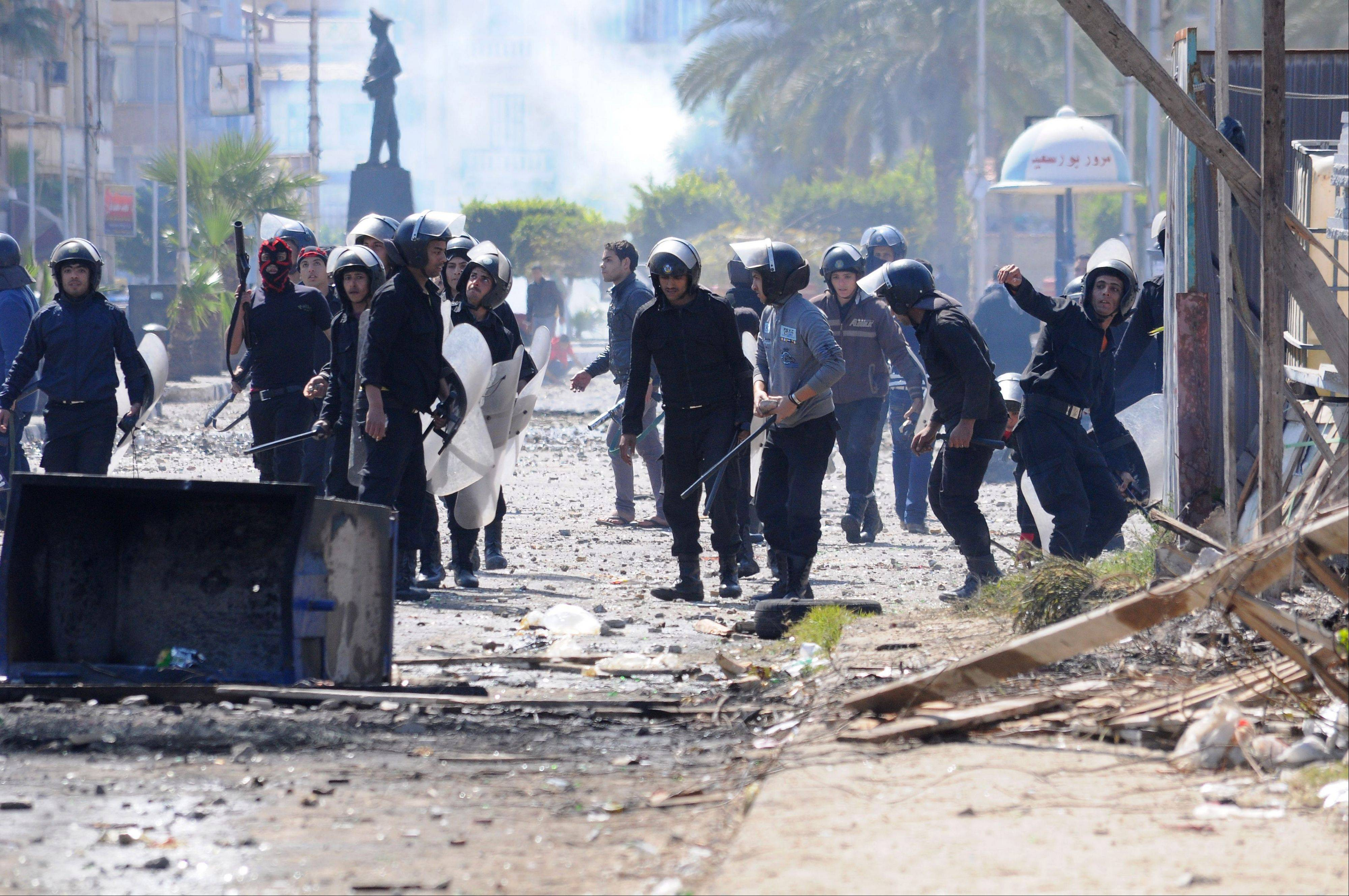 Riot police clash with protesters in Port Said, Egypt, Tuesday, March 5, 2013. Egypt's Islamist president is considering whether to give the military full control of the restive Suez Canal city of Port Said after days of deadly street clashes stoked by excessive use of force by riot police, officials said Tuesday.