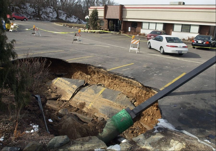 This huge sinkhole took a couple of cars with it when it broke open in the parking lot of the Manor Restaurant in East Dundee in February 2002.