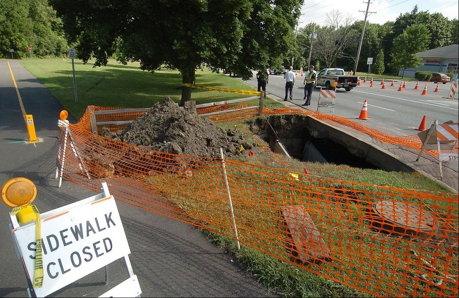 A sinkhole at the northwest corner of Dundee and Hicks roads in Palatine in July 2011 was caused by a collapsed sewer during a heavy summer rainfall.