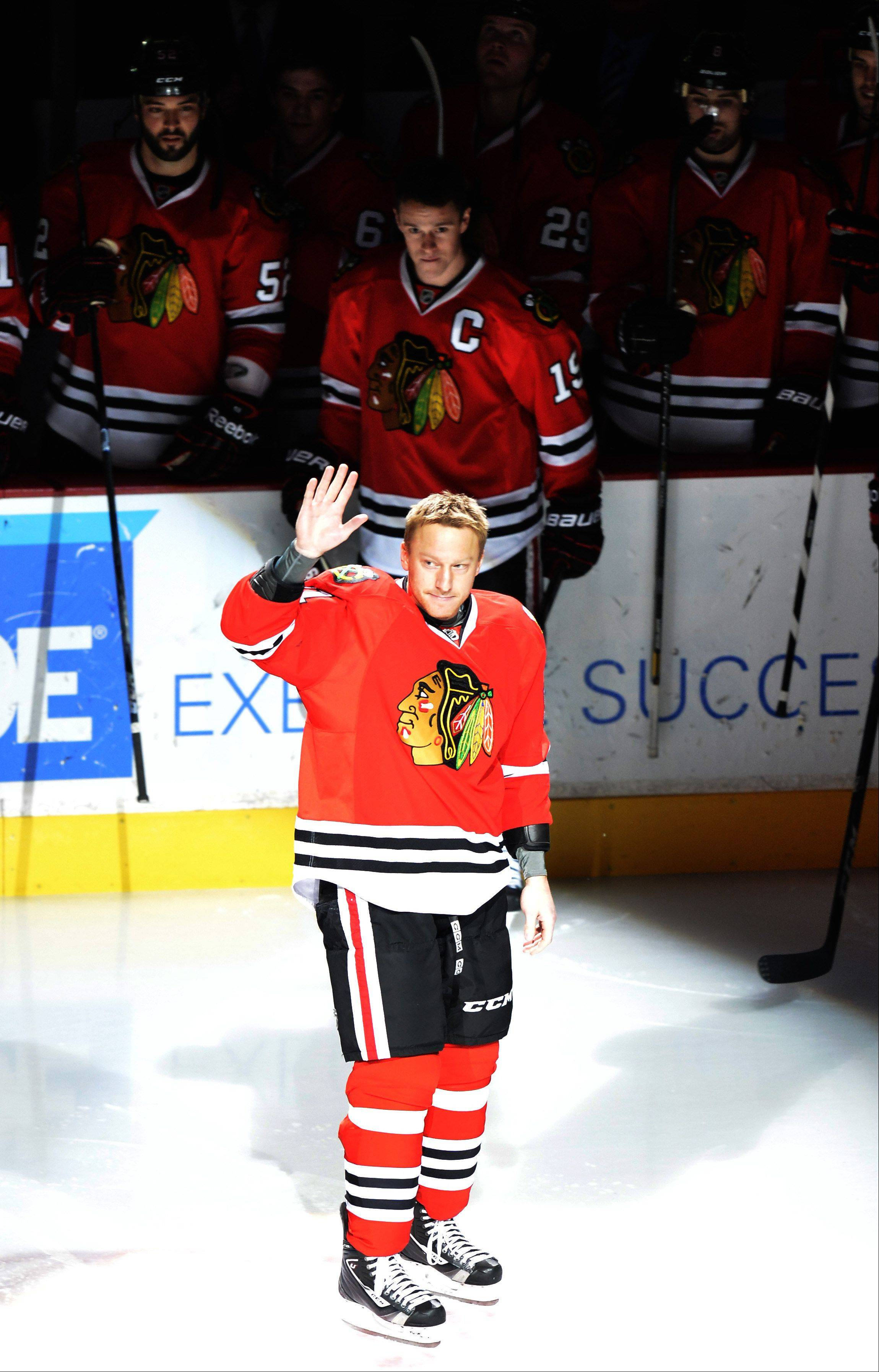 Chicago Blackhawks right wing Marian Hossa of Slovokia is honored before an NHL hockey game against the Minnesota Wild for playing in his 1,000th career game.