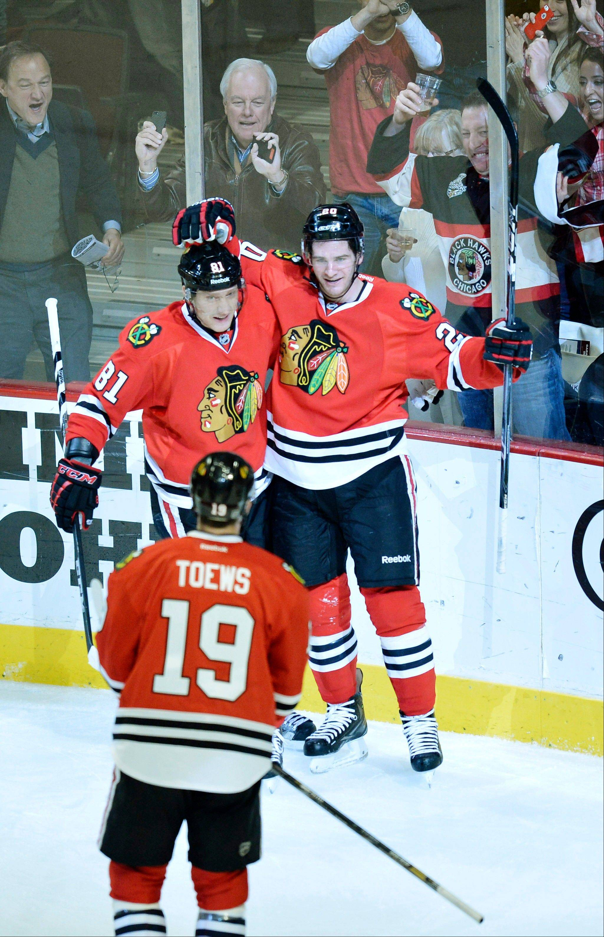 Chicago Blackhawks right wing Marian Hossa of Slovokia, left to right, center Jonathan Toews and left wing Brandon Saad celebrate Saad's goal during the first period.