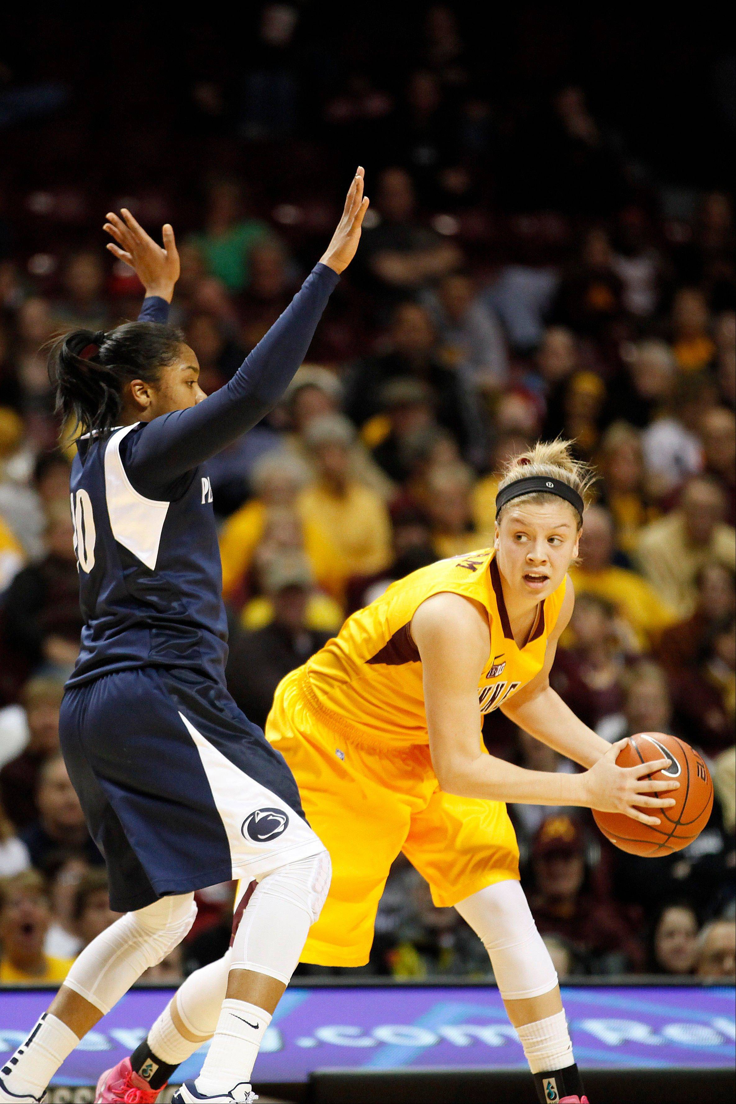 Minnesota guard Rachel Banham, right, looks to make a pass against Penn State guard Alex Bentley (20) in the first half of an NCAA college basketball game on Thursday, Feb. 28, 2013, in Minneapolis.