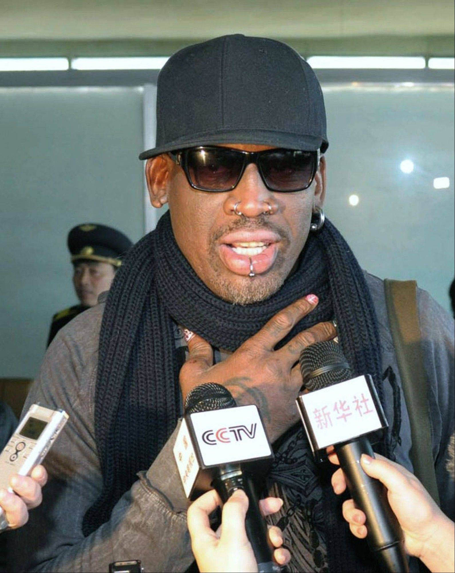 "Former NBA player Dennis Rodman talks with the media at the Pyongyang Airport in Pyongyang before leaving North Korea last Friday. Rodman called leader Kim Jong Un an ""awesome guy""."