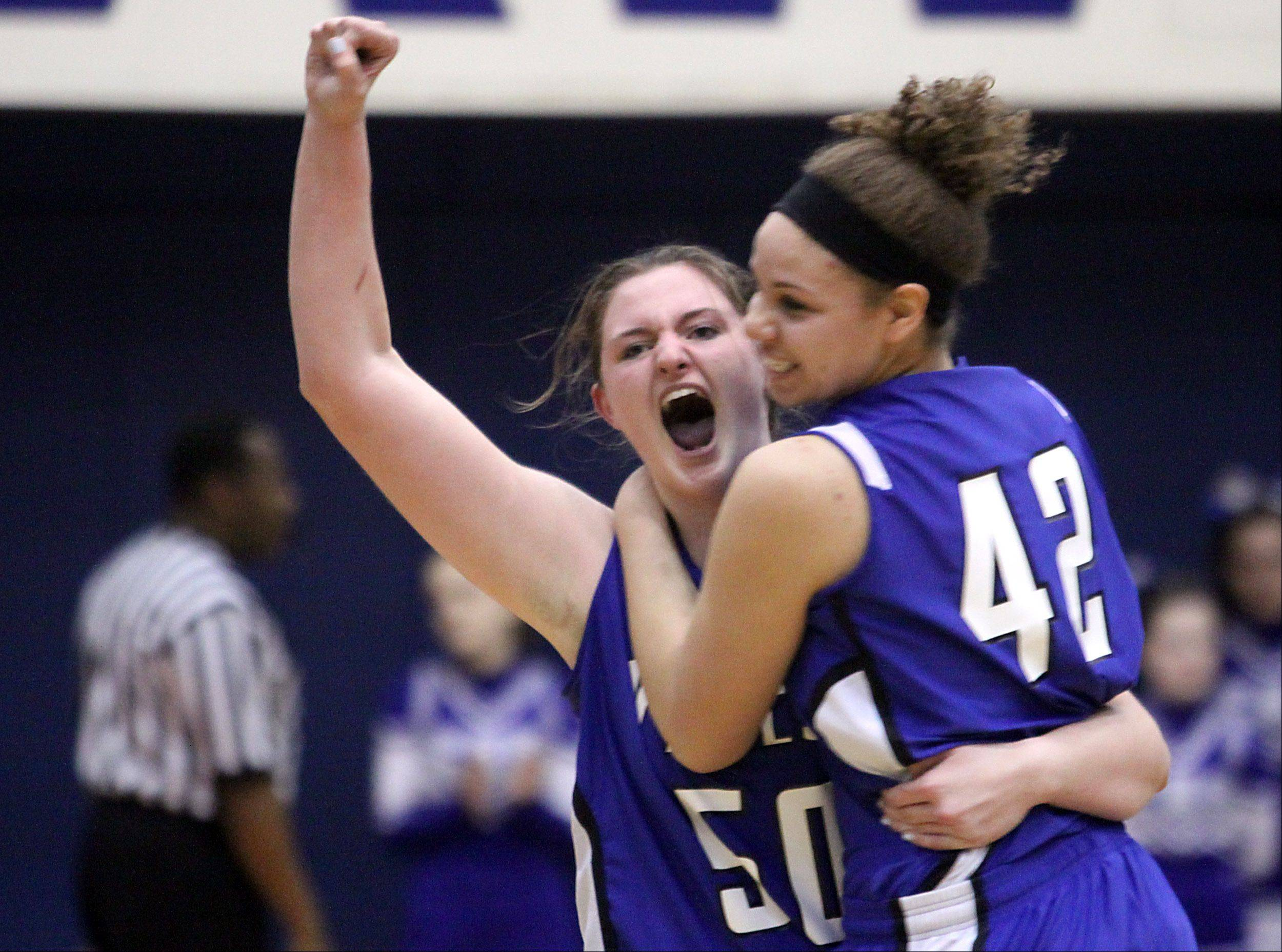 Vernon Hills' Meri Bennett-Swanson, left, and Lauren Webb celebrate their 39-31 Class 3A supersectional win over Burlington Central at Hoffman Estates High School on Monday night.