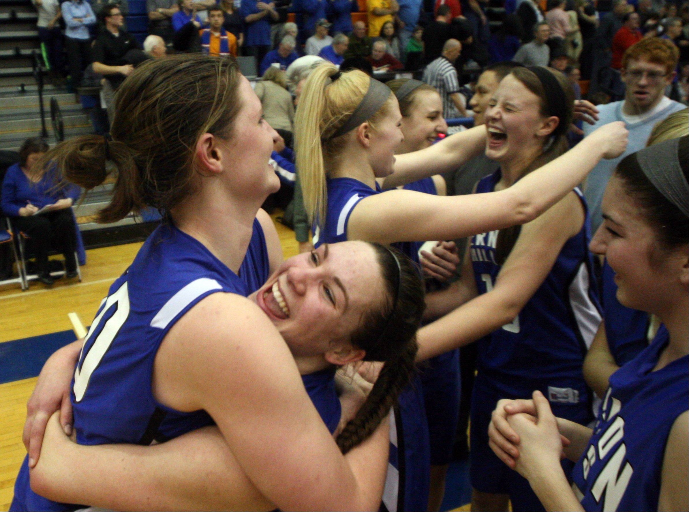 Vernon Hills players react after their 39-31 Class 3A supersectional victory over Burlington Central in Hoffman Estates Monday night.