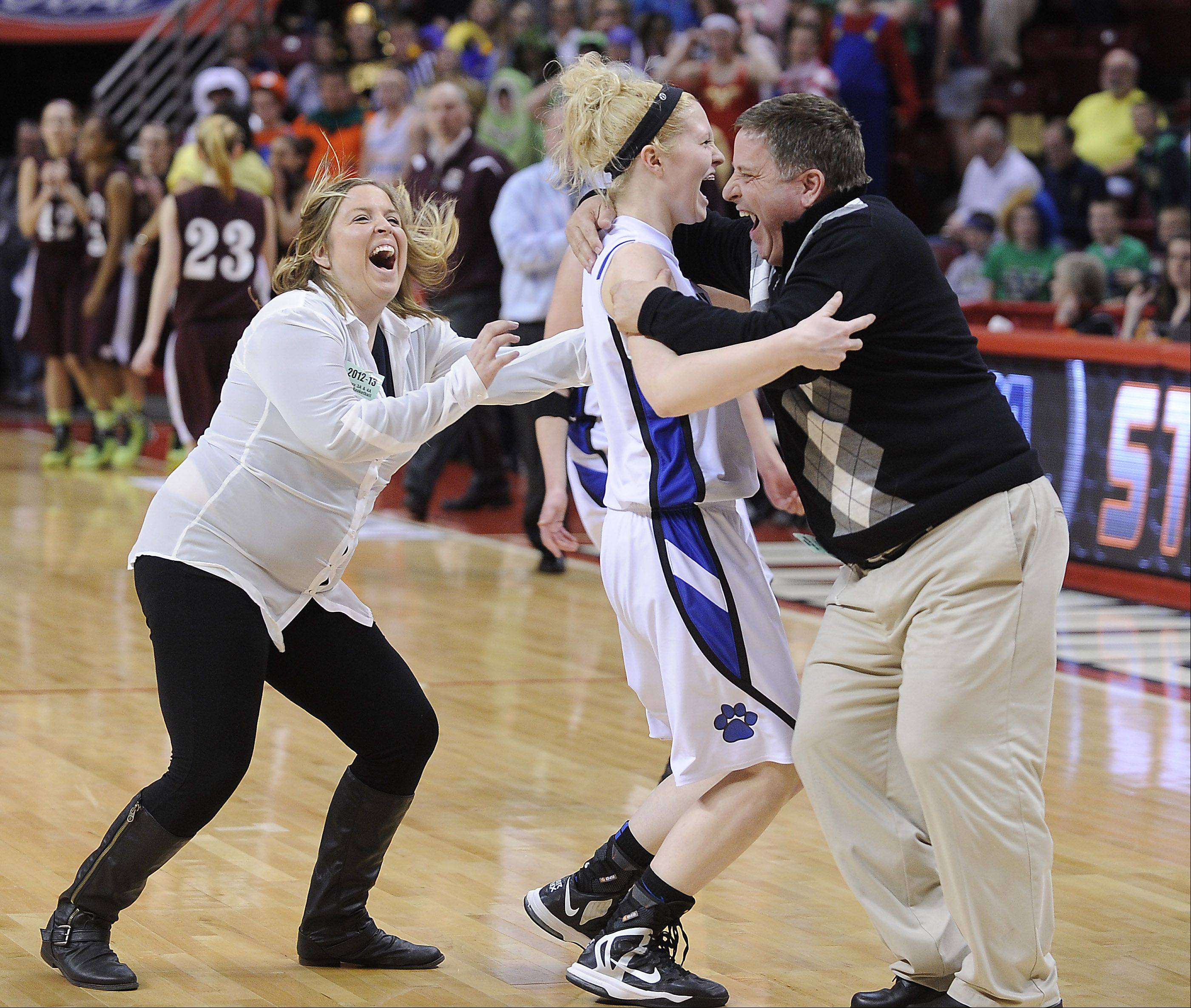 Vernon Hills' Sydney Smith celebrates with her coaches after they beat Montini in overtime at the state Class 3A girls basketball semifinals in Normal on Friday.