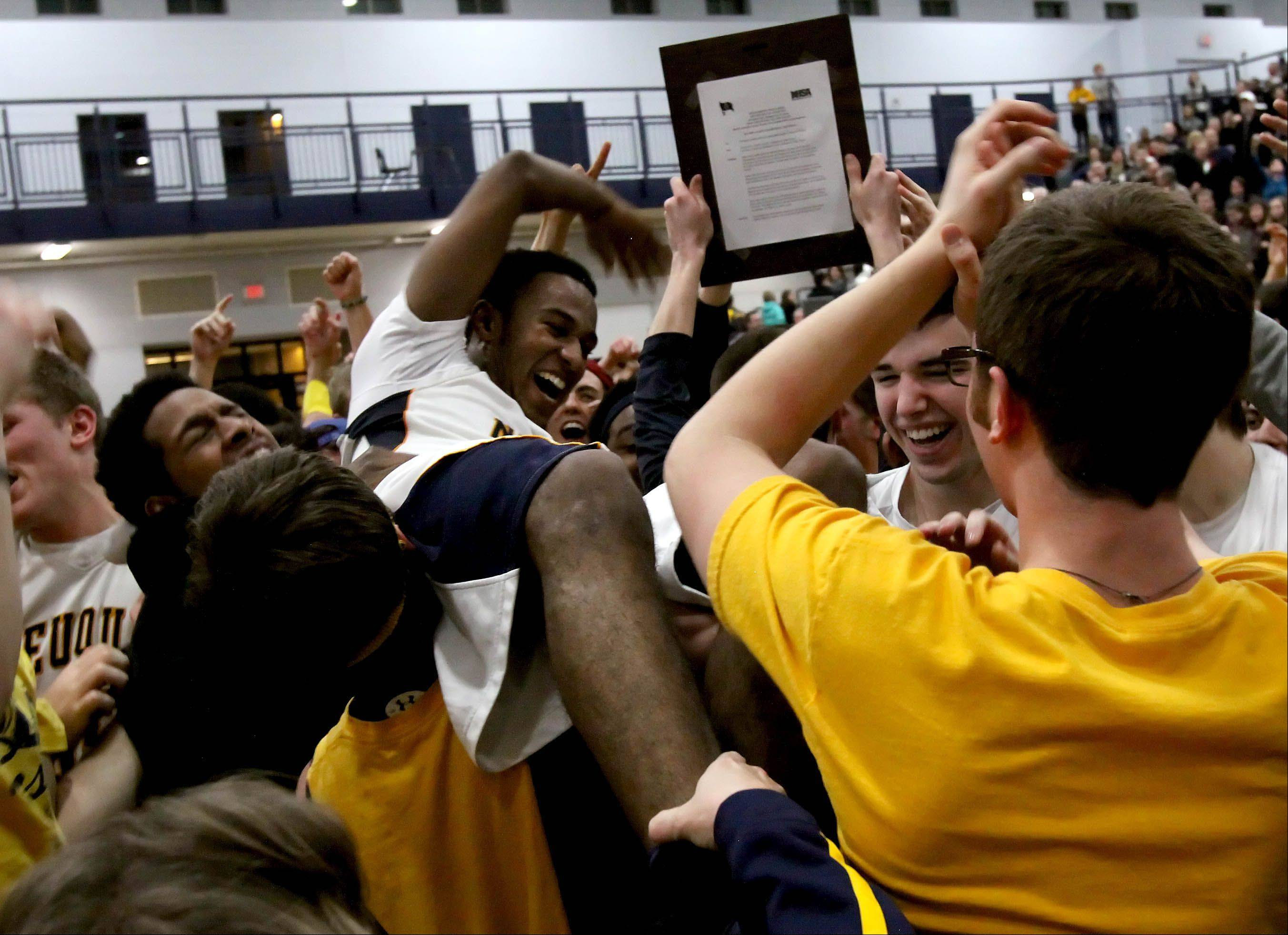 Neuqua Valley's Jabari Sandifer is lifted by the fans after defeating Waubonsie Valley 69-61 in Class 4A boys basketball regional finals at Oswego East on Friday.