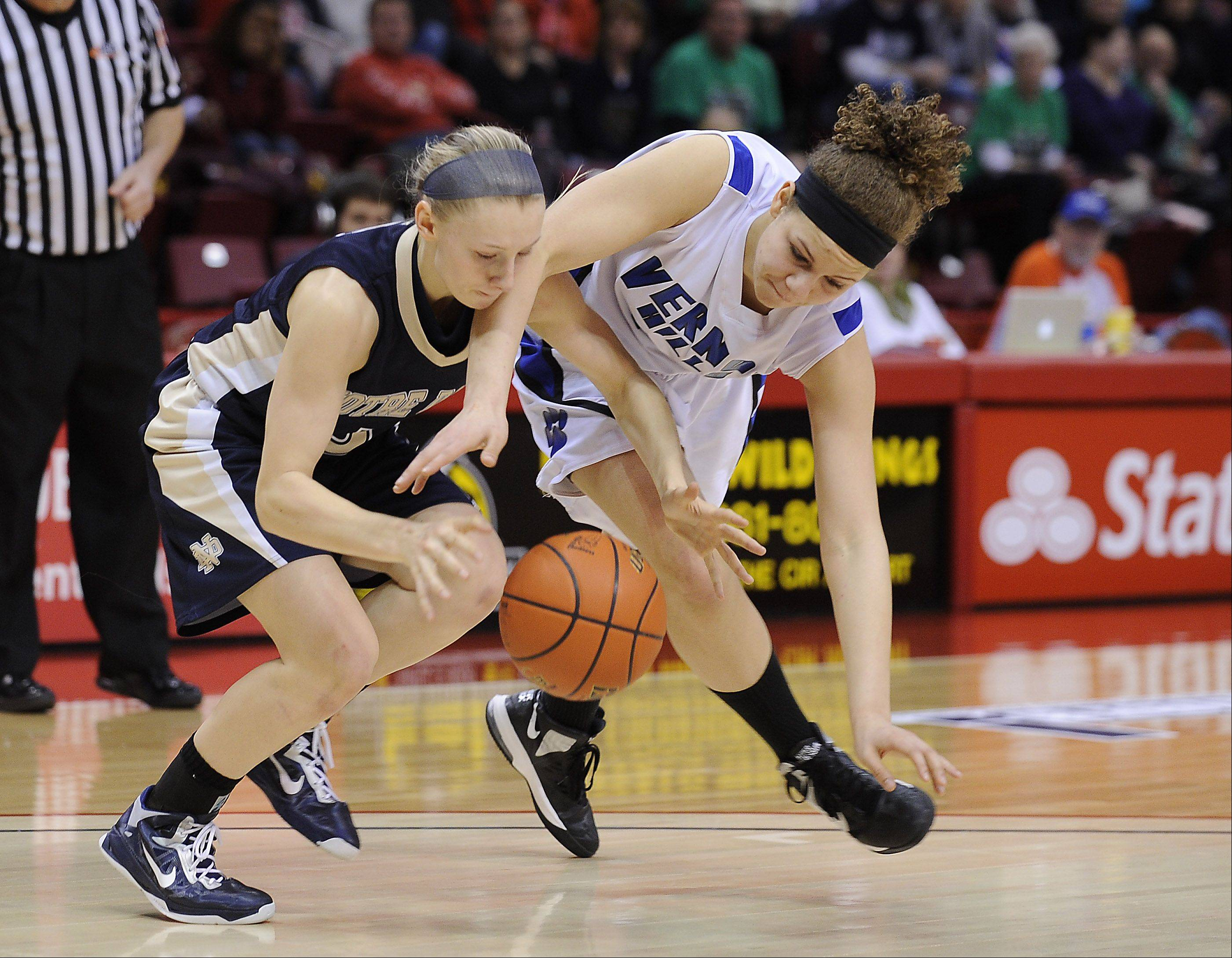 Vernon Hills' Brie Bahlmann and Quincy's Kristen Gengenbacher battle for a loose ball during the 3A Class state girls basketball championship game in Normal on Saturday.